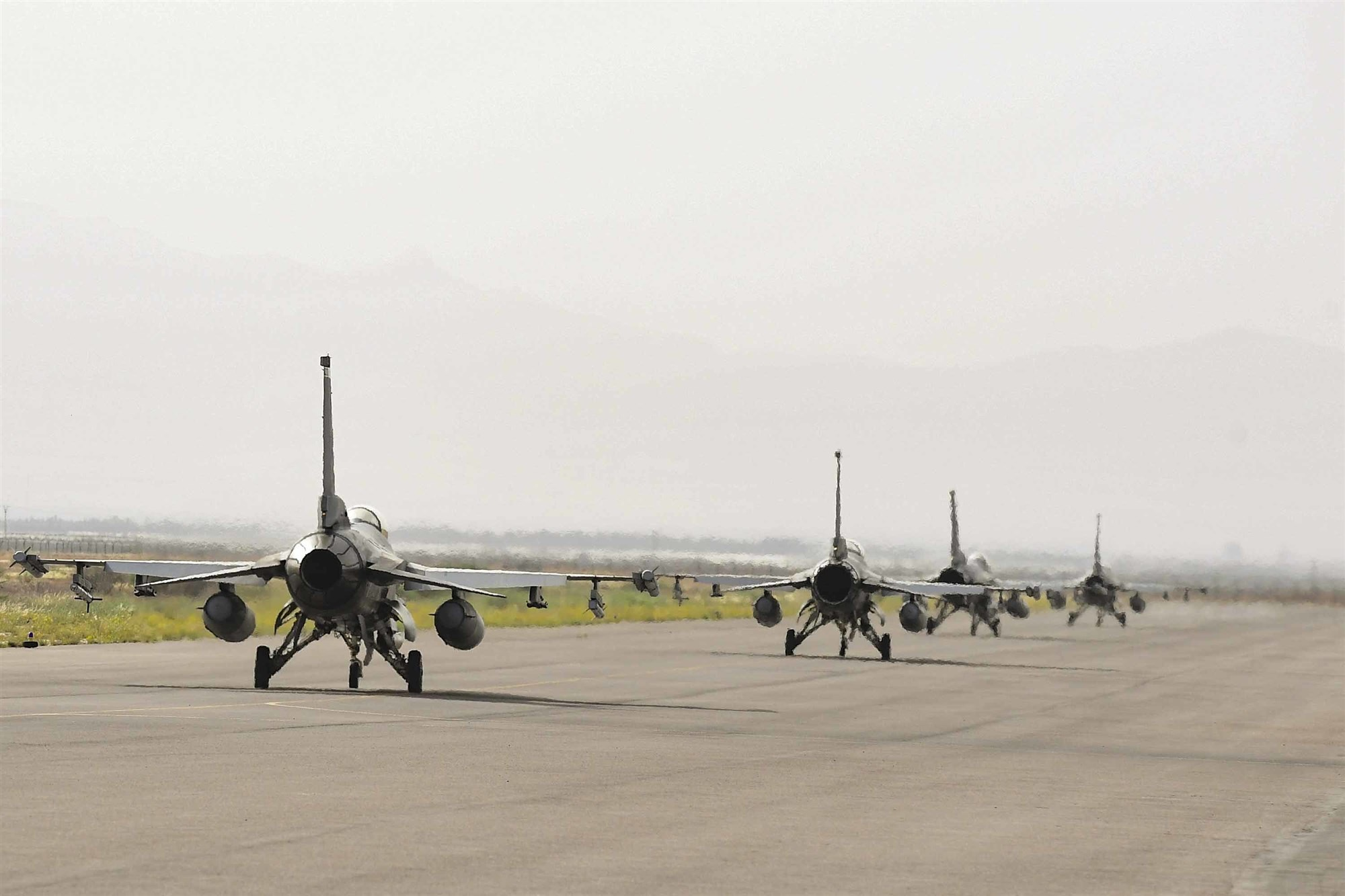 Four F-16C Fighting Falcons from the 555th Expeditionary Fighter Squadron taxi during exercise African Lion 2019 at Ben Guerir Air Base, Morocco, March 25, 2019. African Lion 2019 is a Chairman of the Joint Chiefs of Staff-sponsored, U.S. Africa Command-scheduled, U.S. Marine Corps Forces Europe and Africa-led, joint and combined exercise conducted in the Kingdom of Morocco with a spoke in Tunisia, and armed forces participants in from Canada, France, Senegal, Spain, and the United Kingdom. (U.S. Air Force photo by Staff Sgt. Ceaira Tinsley)