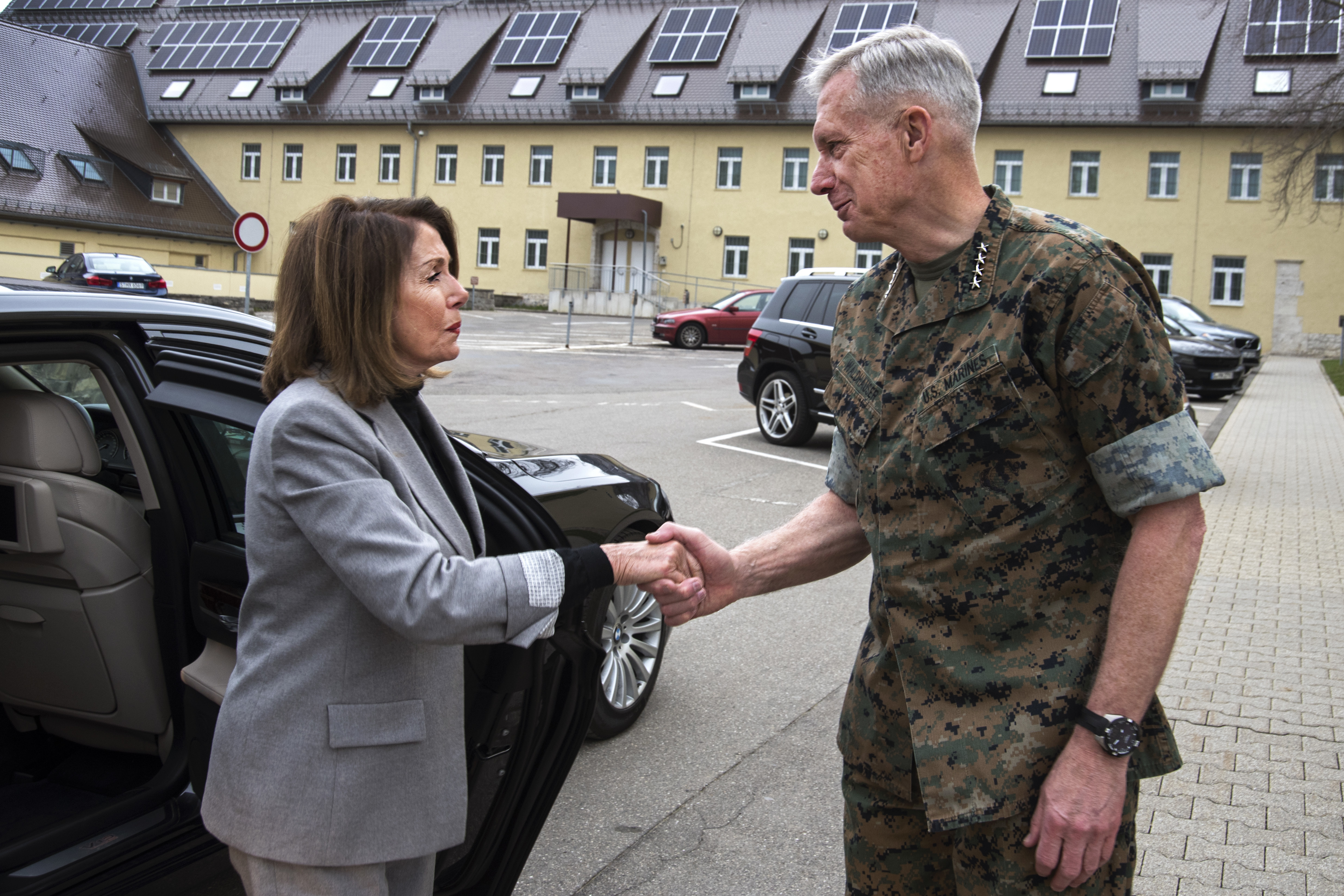 Marine Corps Gen. Thomas Waldhauser, commander, U.S. Africa Command, greets Speaker of the House Nancy Pelosi during a visit April 13, 2019 in Stuttgart, Germany. Pelosi along with a congressional delegation visited AFRICOM to gain insight about the command's operations and activities supporting the U.S. strategy for Africa. (U.S. Navy photo by Mass Communication Specialist 1st Class Christopher Hurd/Released)