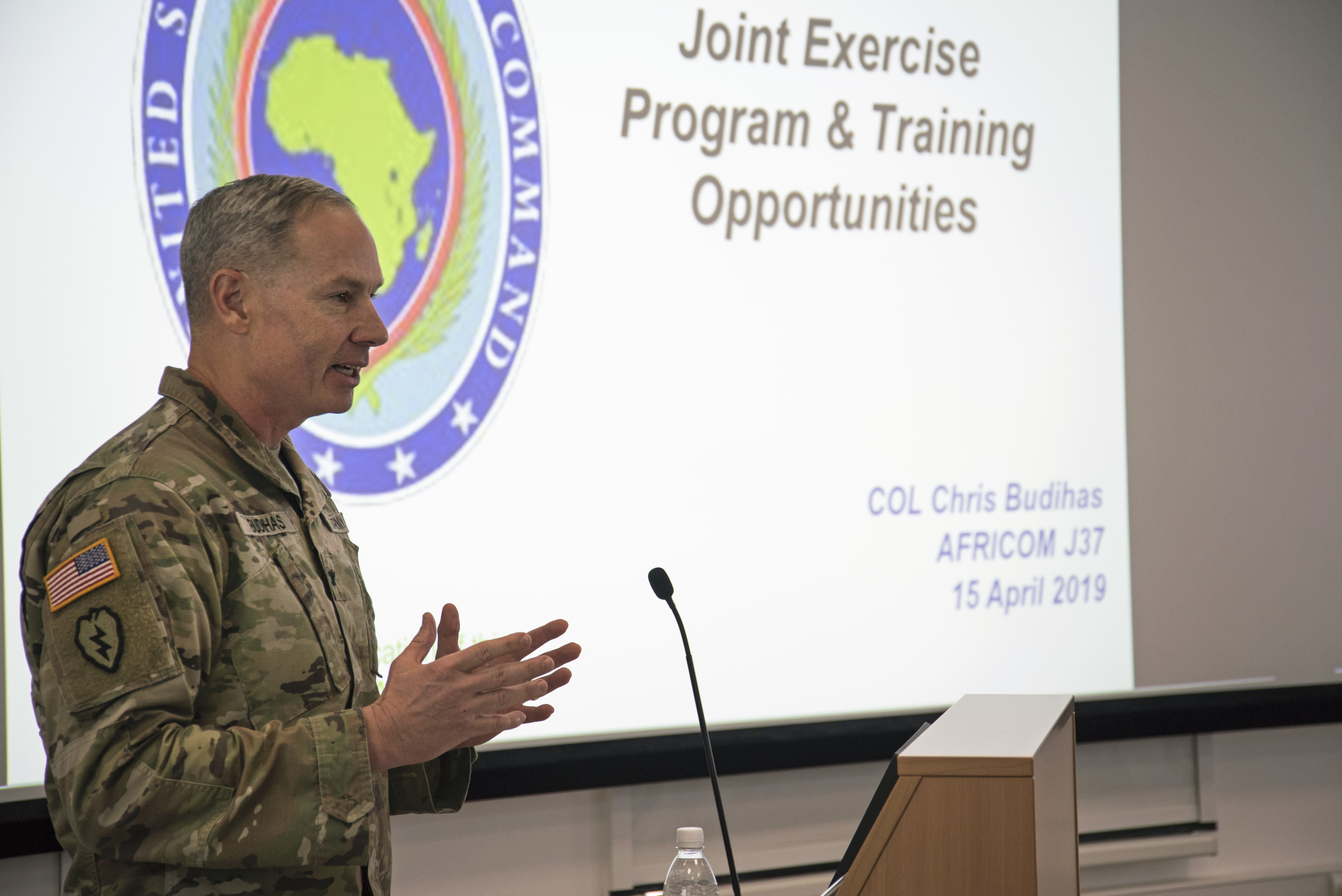 Army Col. Chris Budihas, chief of training, readiness and exercises at AFRICOM, speaks to attendees during The 2019 Adjutant General State Partnership Program Conference April 15 in Stuttgart, Germany. Budihas spoke about upcoming exercises and training opportunities for National Guard units and there partnering nations. (U.S. Navy photo by Mass Communication Specialist 1st Class Christopher Hurd/Released)