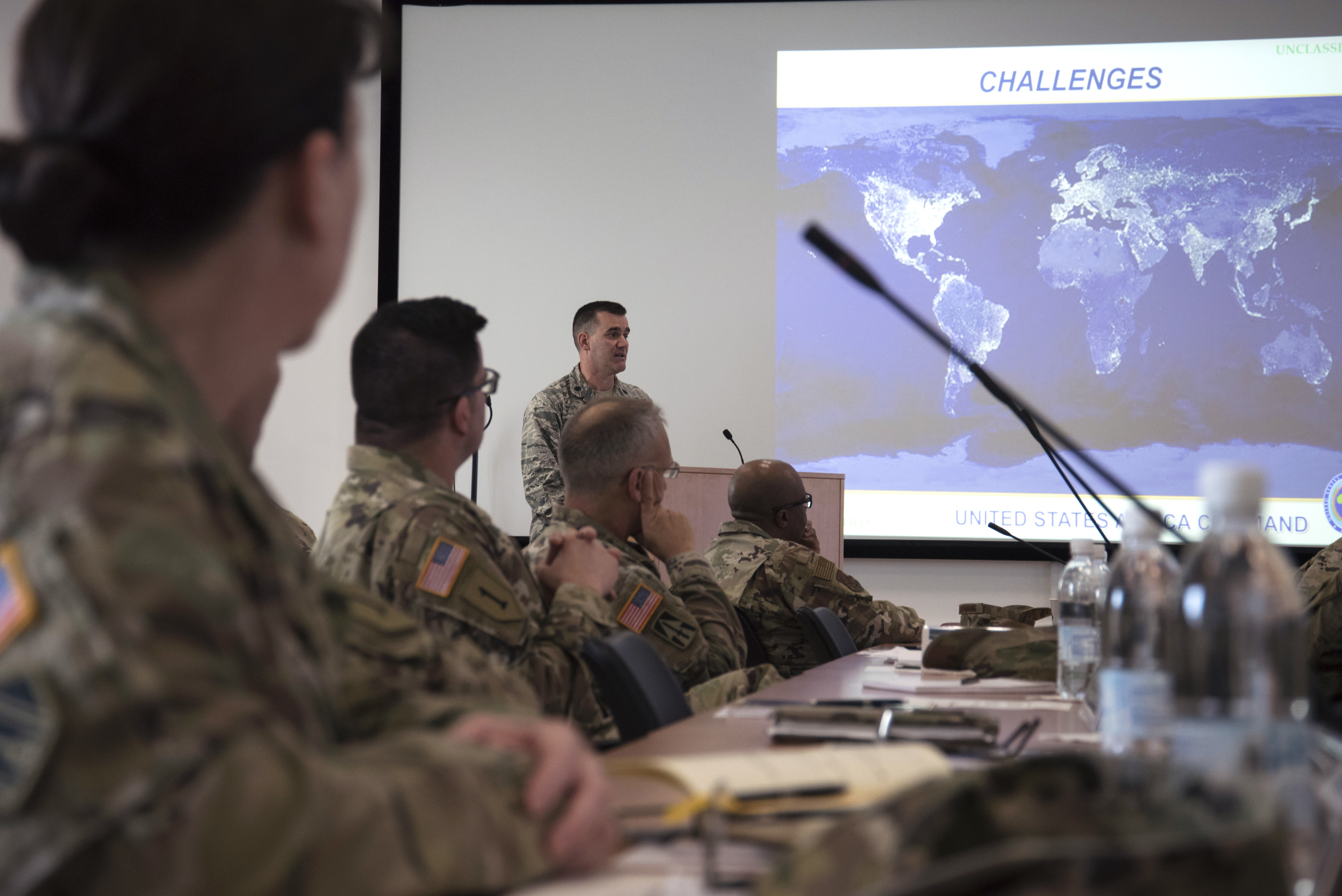 Air Force Lt. Col. Marcel Arel, AFRICOM multinational cooperation center, speaks to attendees of The 2019 Adjutant General State Partnership Program Conference April 15 in Stuttgart, Germany. Arel gave a brief overview of the AFRICOM mission and the challenges taking place in Africa. (U.S. Navy photo by Mass Communication Specialist 1st Class Christopher Hurd/Released)