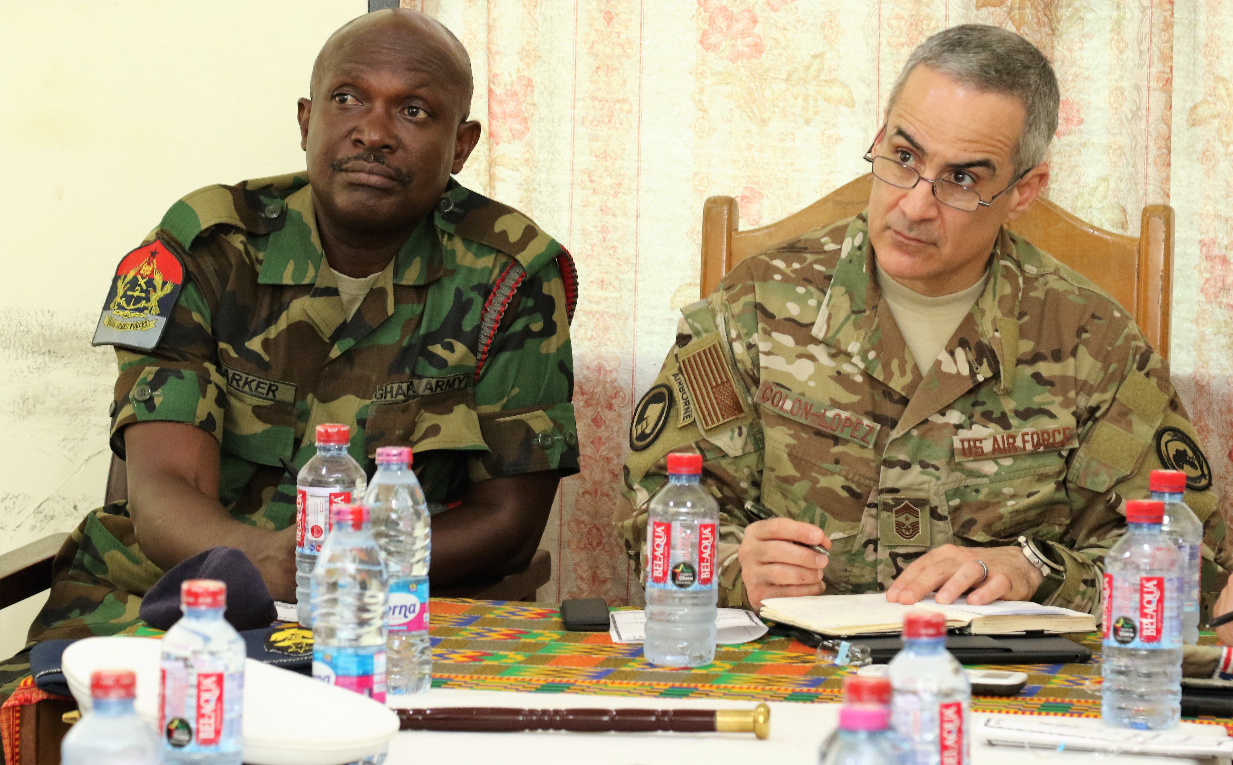 U.S. Air Force Command Chief Master Sgt. Ramon Colon-Lopez, command senior enlisted leader, U.S. Africa Command, and Chief Warrant Officer Ramous Barker, forces sergeant major, Ghana Armed Forces, receive a briefing at the Shai Hills Army Recruit Training School near Accra, Ghana April 16, 2019.