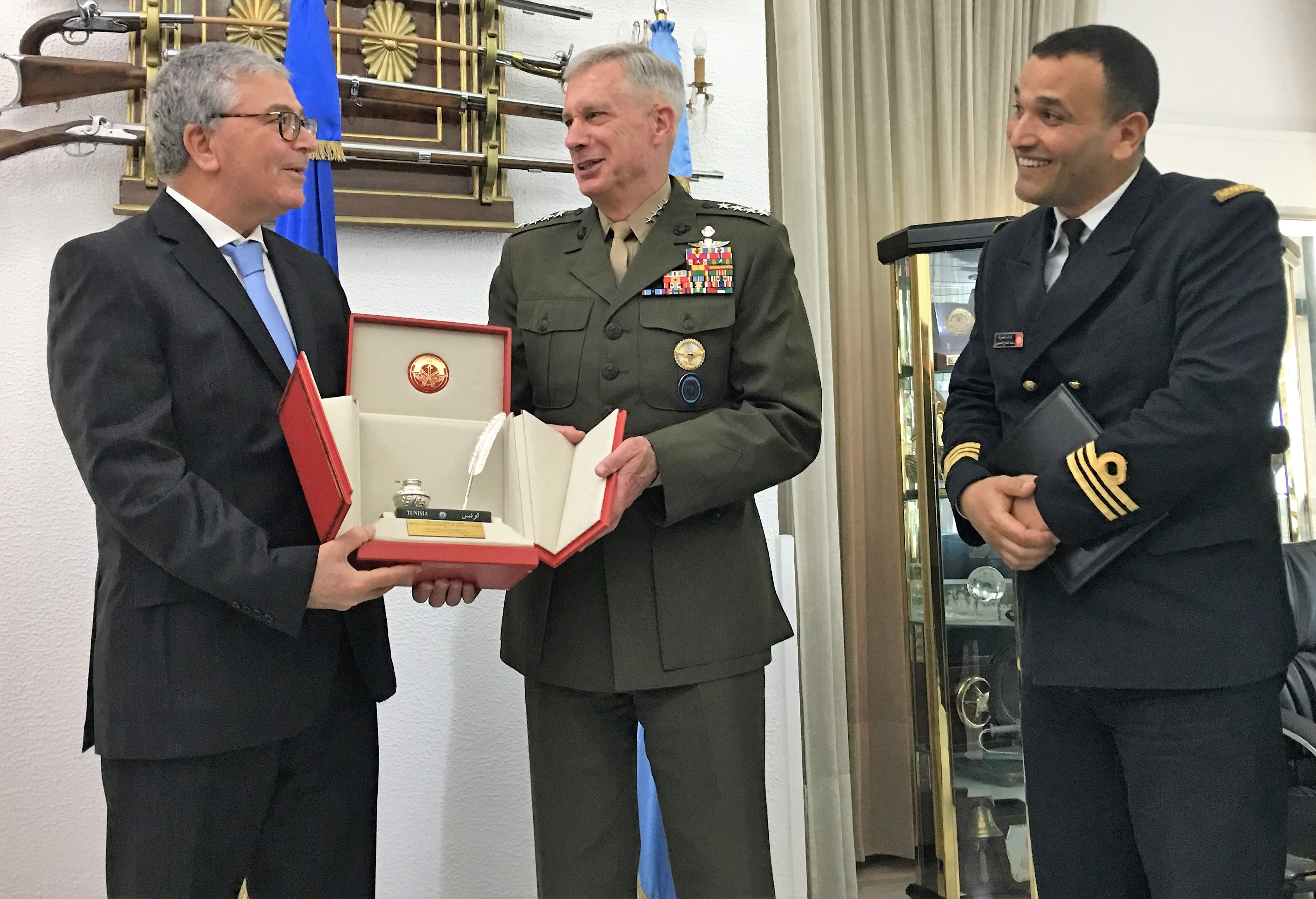 Marine Corps Gen. Thomas D. Waldhauser, commander, U.S. Africa Command, receives a gift of appreciation from Tunisian Minister of Defense Abdelkrim Zbidi May 16, 2019. Waldhauser met with Tunisian military officials to discuss security concerns in the region and opportunities to strengthen partnerships.