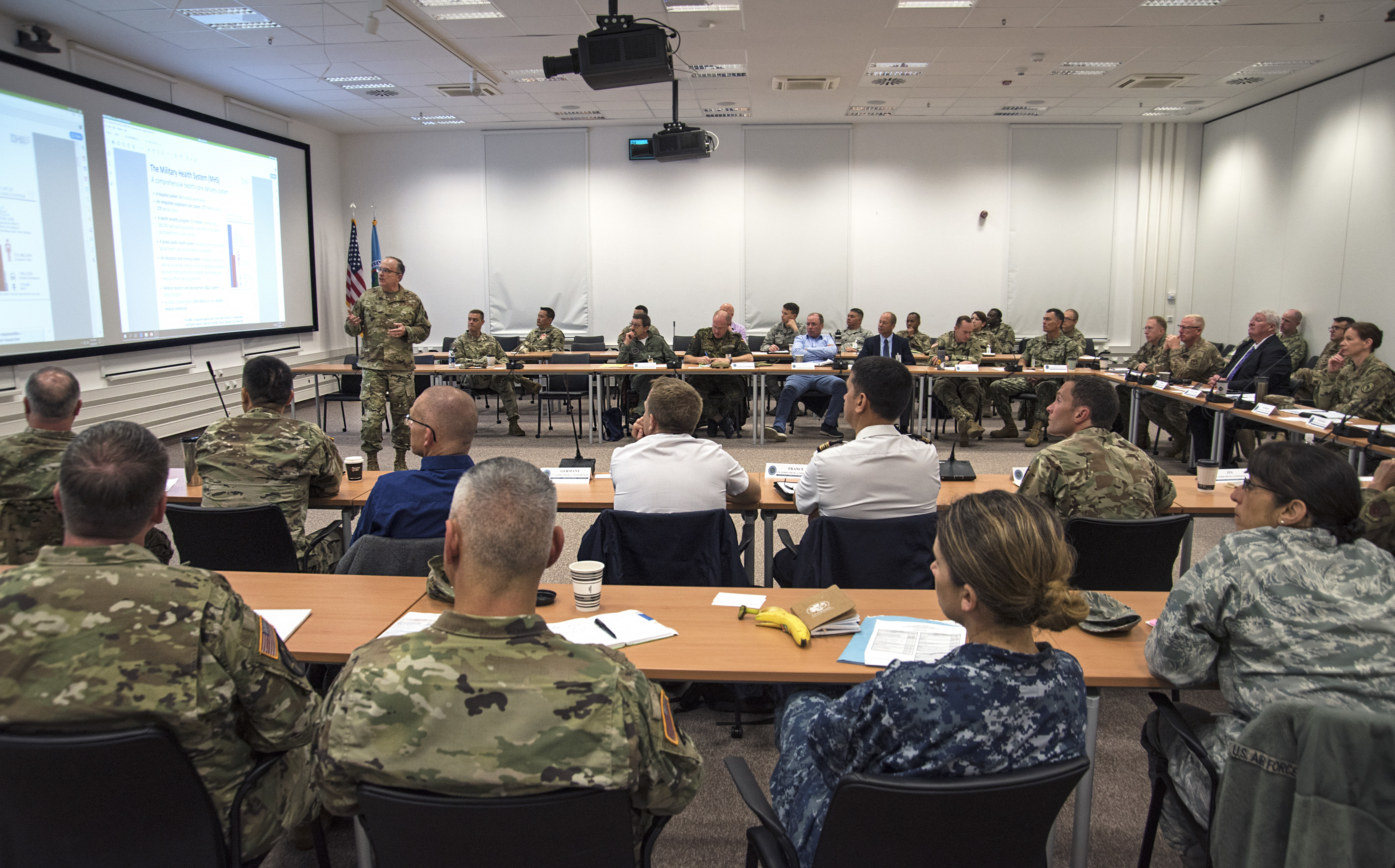 Attendees listen to a brief on the upcoming changes to the military health system during day one of the 2019 U.S. Africa Command Command Surgeon Synchronization Conference May 28, 2019 in Stuttgart, Germany. The conference brought together medical professionals from across the command, and interagency and foreign partners, to enable collaboration and to discuss areas of concern within the medical enterprise in Africa. (U.S. Navy photo by Mass Communication Specialist 1st Class Christopher Hurd/Released)