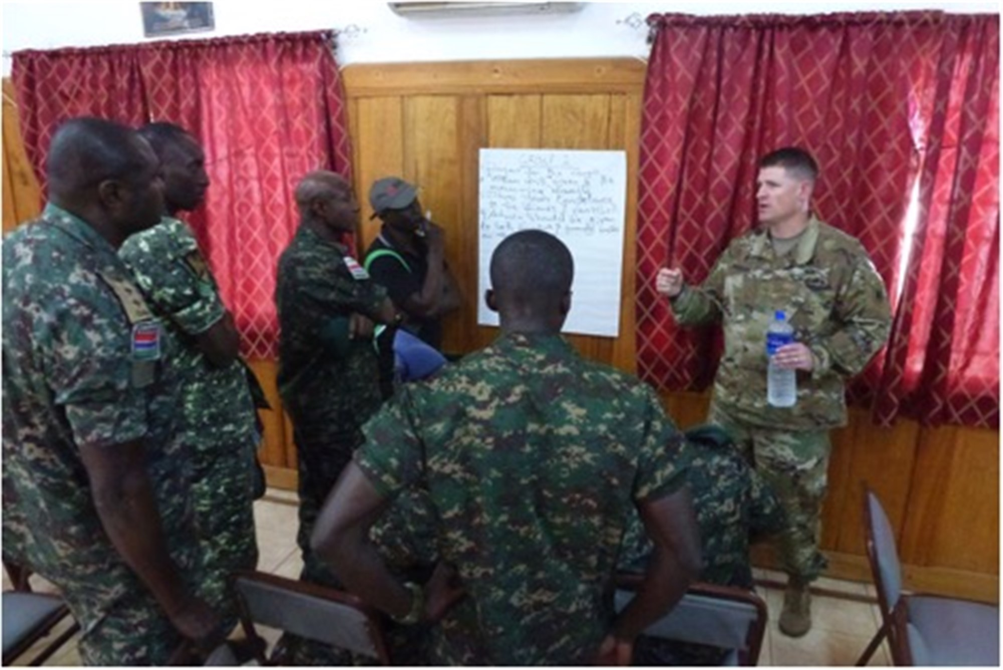 Chpalin (Maj.) Matthew Madison, the U.S. Army Africa Chaplain, right, leads a small group session with the Gambia Armed Forces chaplains during an event held April 23-26, 2019, at the Gambia pastoral Institute in Banjul, Gambia. (U.S. Army photo)