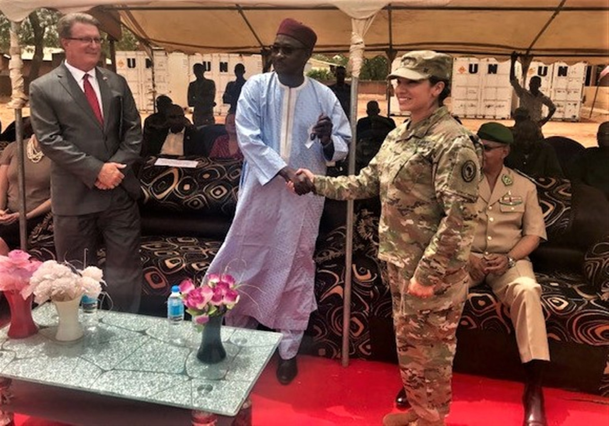 U.S. Army Maj. Maia Molina-Schaefer, chief, Office of Security Cooperation hands the keys to the U.S. provided vehicles to Kalla Moutari, Nigerien Defense Minister, during the G5 Sahel Equipment Handover Ceremony at the Direction Centrale du Materiel in Niamey, Niger, June 6, 2019. The equipment, which is the first shipment of the more than $21 million the United States has pledged to provide to Niger for the G5 Sahel efforts, included transport, fuel and water trucks; GPS-enabled navigation systems; fuel containers; military tents and individual soldier equipment.  (Courtesy photo)