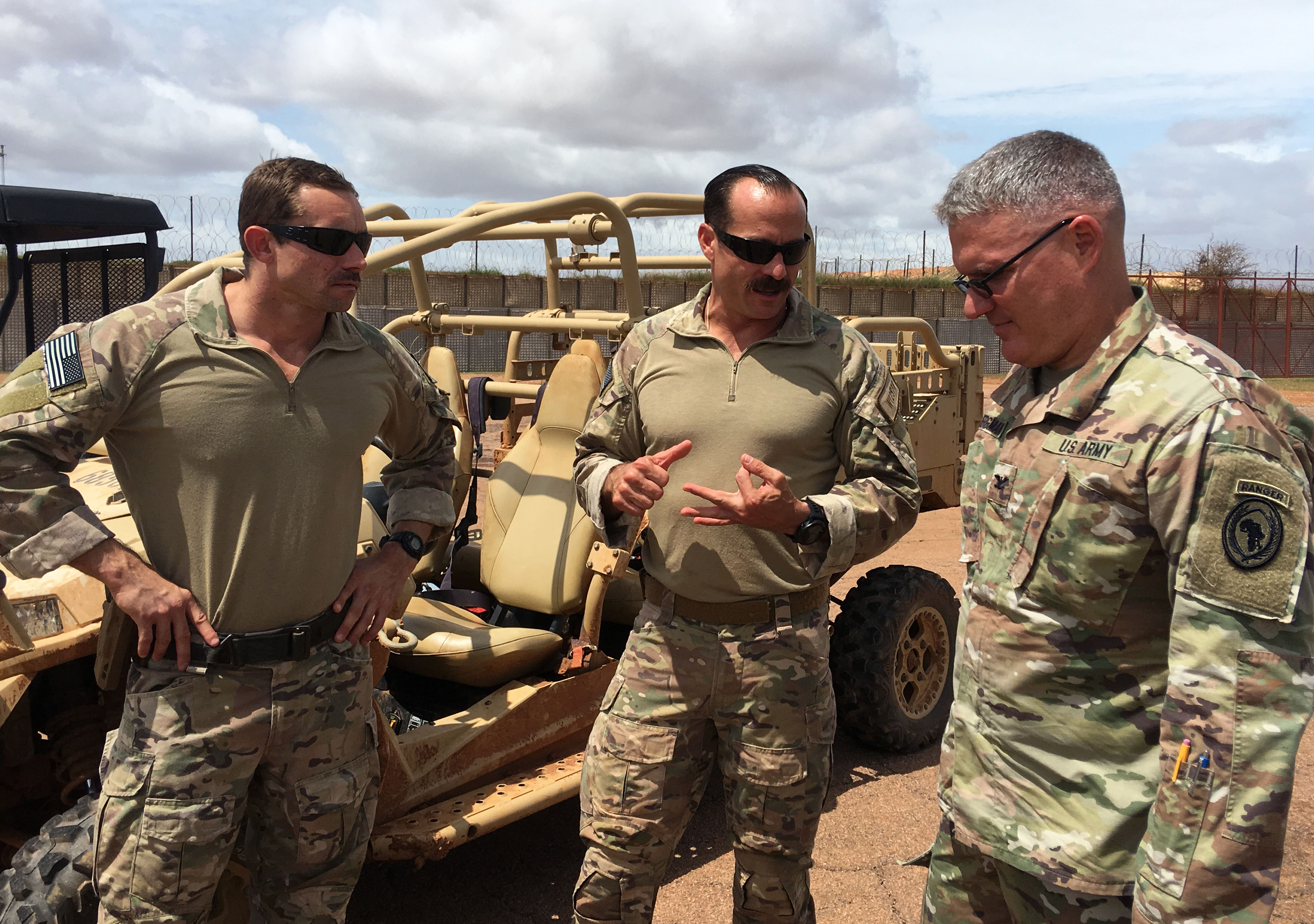 U.S. Army Col. Charles Bergman, lead integrator for U.S. Africa Command operations in Africa, receives a brief from U.S. personnel at a forward operating location in Somalia, June 11, 2019.  AFRICOM senior leaders visited the forward deployed unit to assess progress in enhancing Somali defense capabilities.