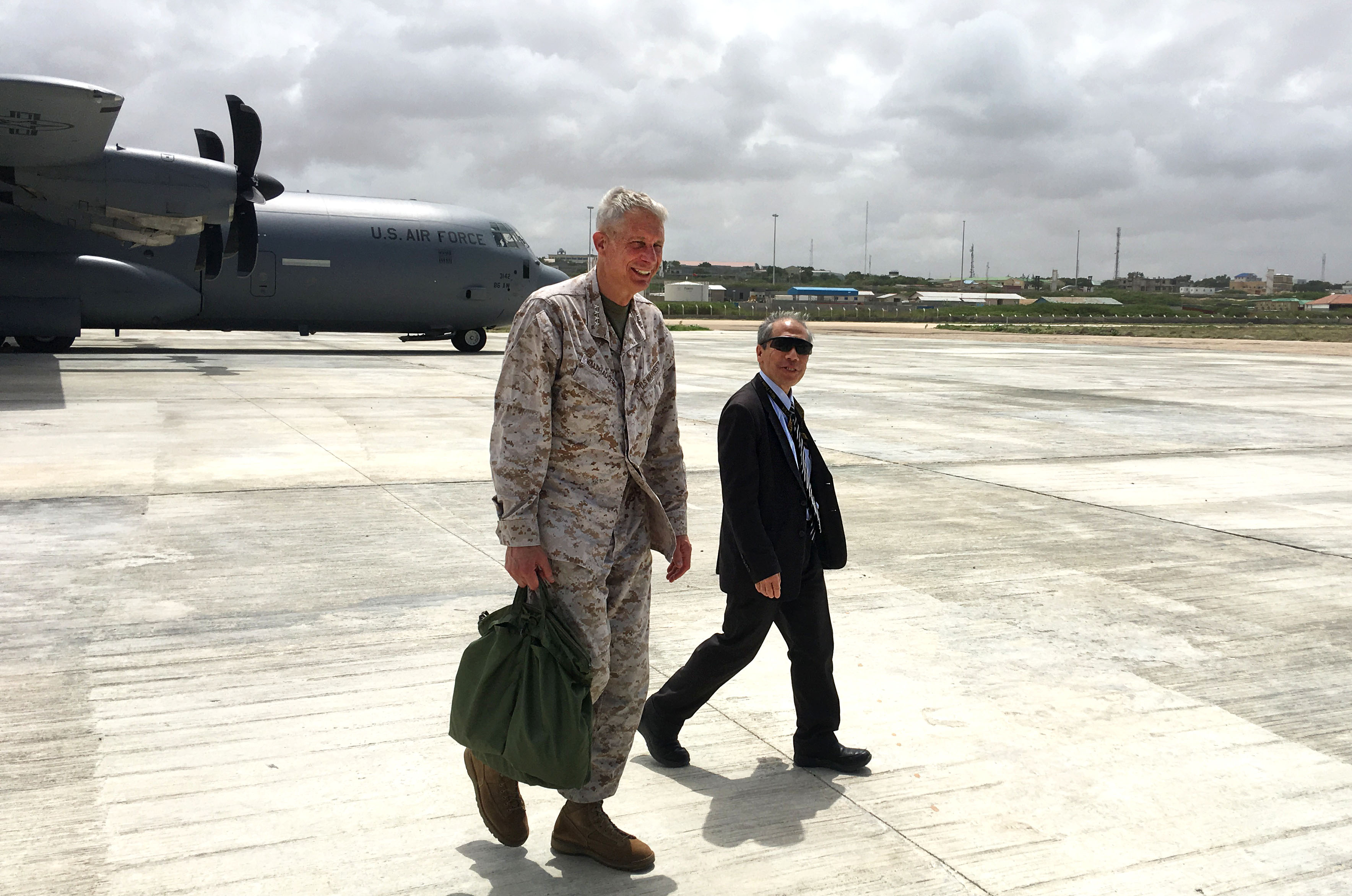 Ambassador Donald Yamamoto, U.S. Ambassador to Somalia, greets U.S. Marine Corps Gen. Thomas D. Waldhauser, commander, U.S. Africa Command during a visit June 11, 2019 in Mogadishu, Somalia. During the trip, Waldhauser and Yamamoto met with Prime Minister Hassan Ali Khaire and key Somali defense officials.