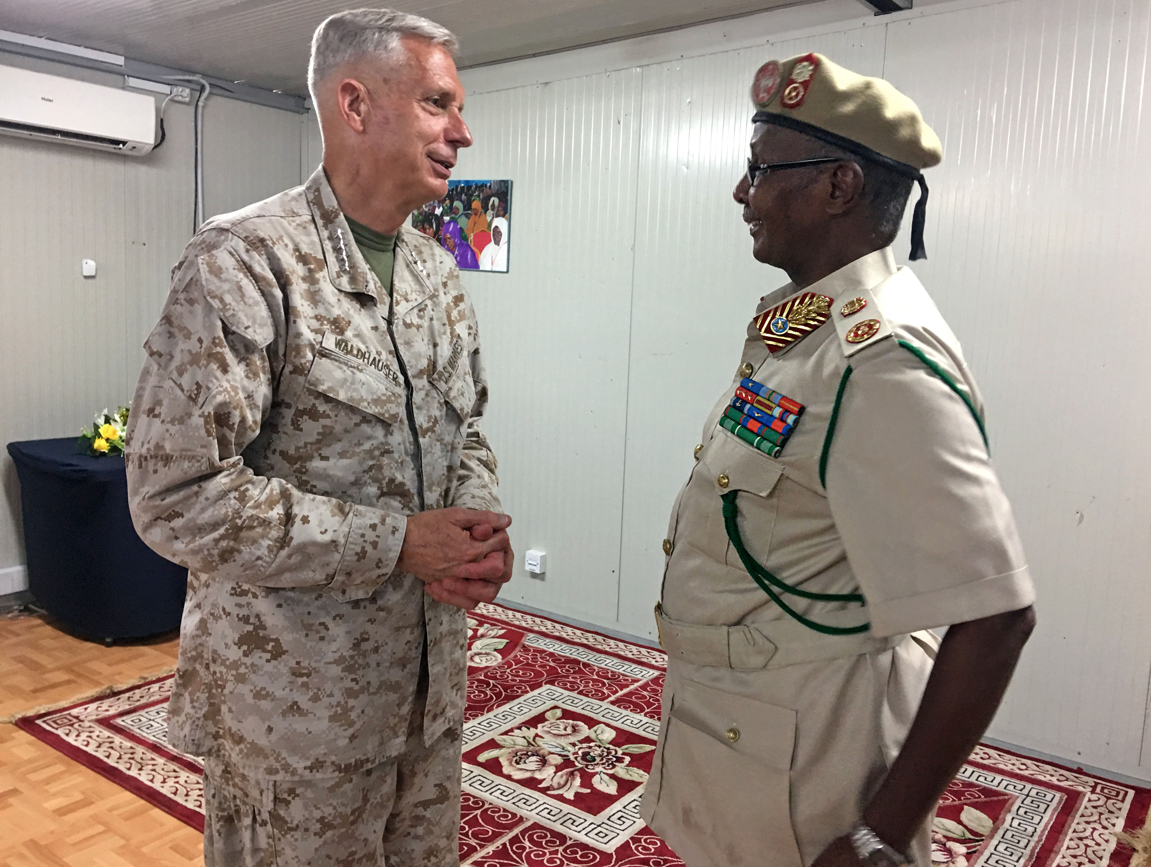 U.S. Marine Corps Gen. Thomas D. Waldhauser, commander, U.S. Africa Command, discusses U.S. and Somalia partnering efforts with Somali Maj. Gen. Dahir Adan Elmi, Somali Chief of Defense Forces, during a meeting in Mogadishu, Somalia, June 11, 2019. The overarching goal in Somalia for AFRICOM is to help the Federal Government of Somalia provide a safe and secure environment for the people of Somalia, deter organizations such as al-Shabaab and ISIS-Somalia from expanding, and promote regional security.