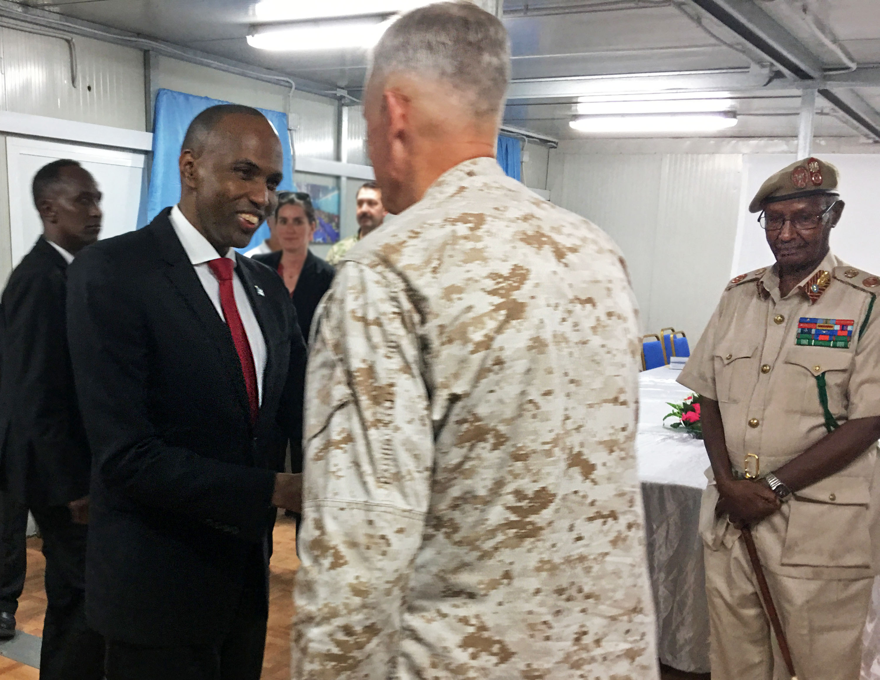 Somali Prime Minister Hassan Ali Khaire greets U.S. Marine Corps Gen. Thomas D. Waldhauser, commander, U.S. Africa Command, June 11, 2019 in Mogadishu, Somalia. During the visit AFRICOM senior leaders met with key Somali leaders to discuss progress the U.S. interagency team witnessed in Somalia, as well as U.S. whole-of-government support for the Federal Government of Somalia.