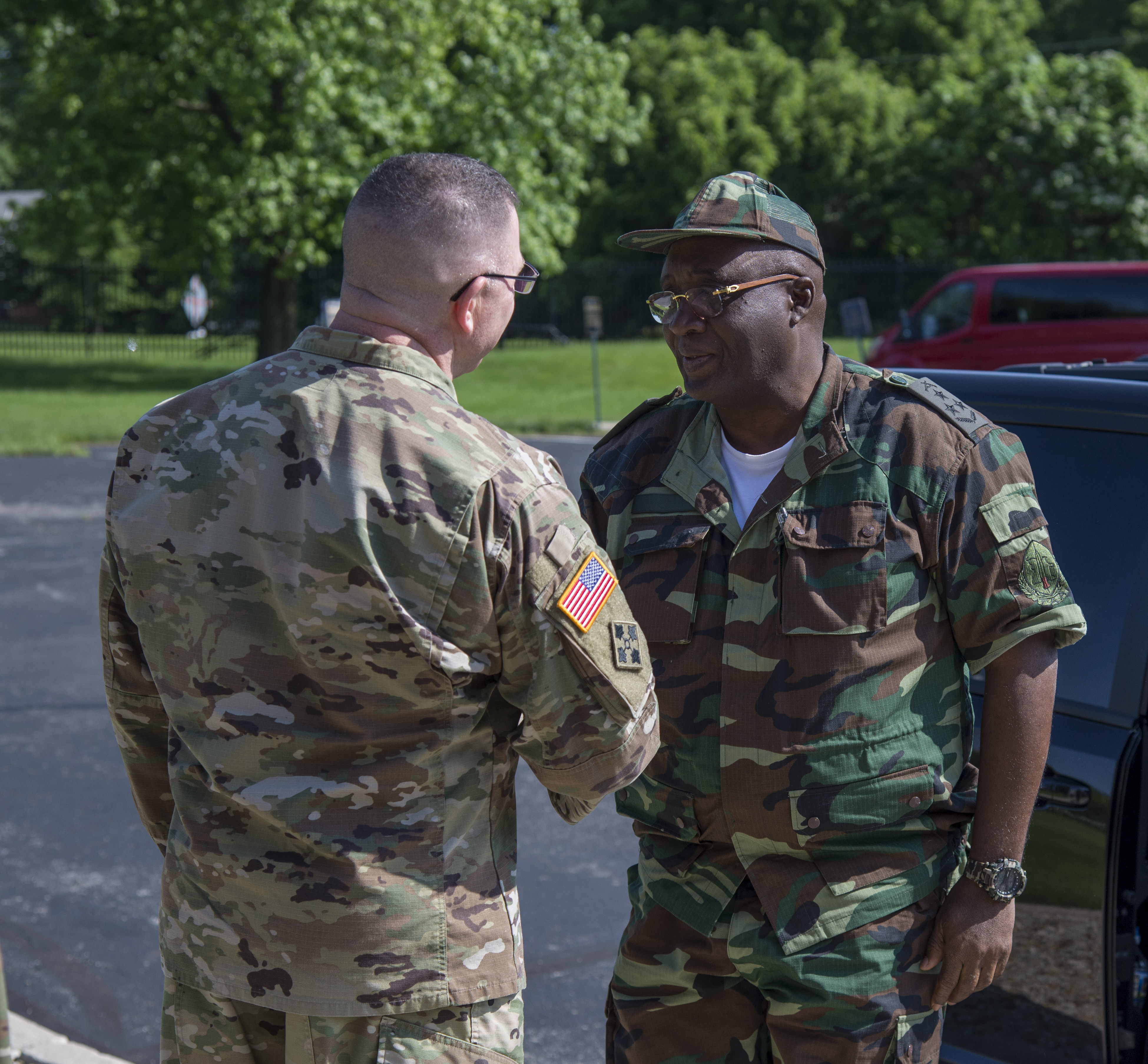 Col. Daniel Shank (left), Ohio assistant adjutant general for Army, greets Gen. Jaques Raul, deputy land forces commander of the Angolan Armed Forces, as his delegation arrives at the Maj. Gen. Robert S. Beightler Armory in Columbus, Ohio, June 4, 2019. The State Partnership Program organized the visit, which enabled meetings and discussions between Angolan military and Ohio National Guard leadership.