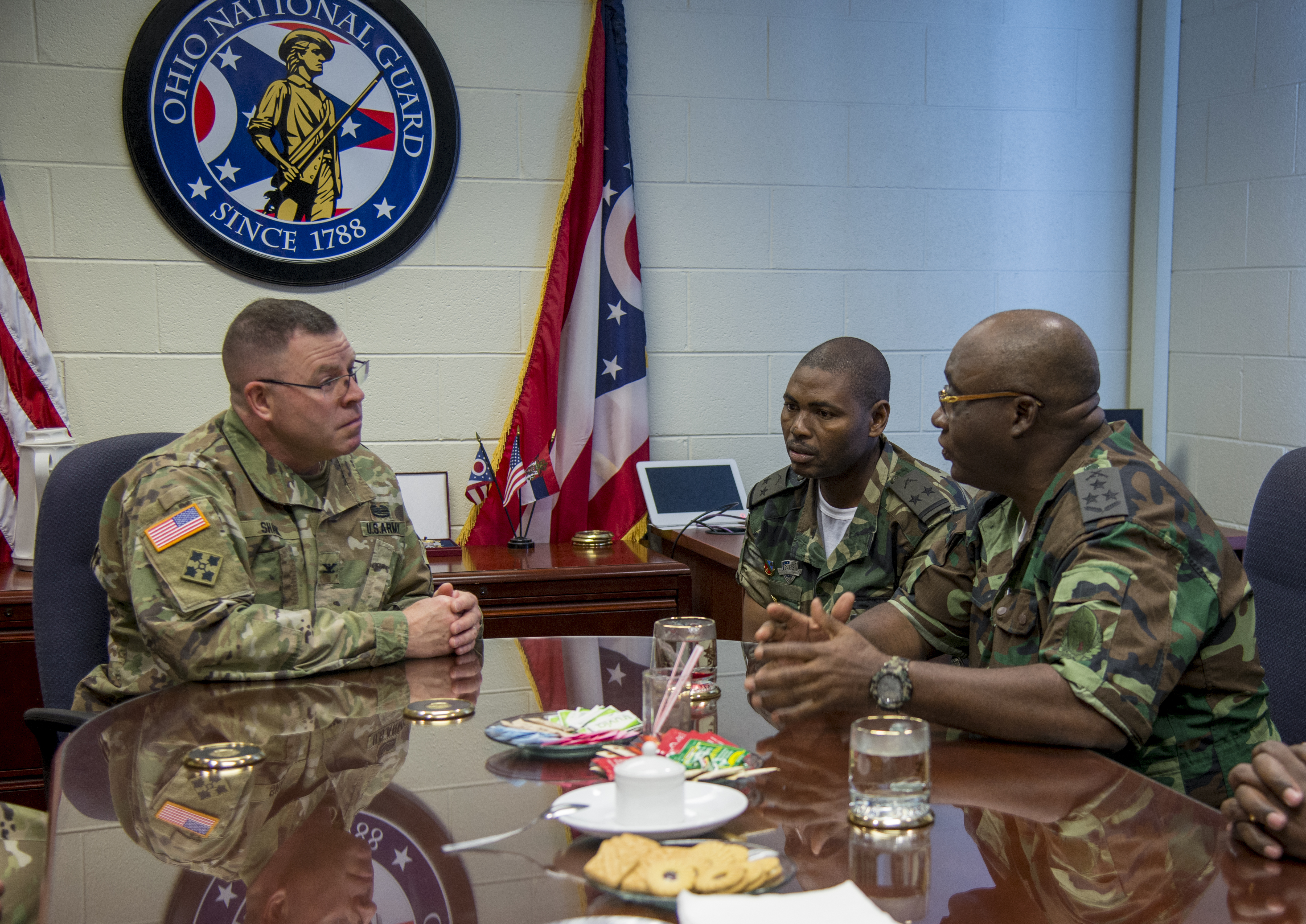 Gen. Jaques Raul (from right), deputy land forces commander of the Angolan Armed Forces, and Lt. Col. Pedro Receado, Raul's executive officer, meet with Col. Daniel Shank, Ohio assistant adjutant general for Army, at the Maj. Gen. Robert S. Beightler Armory in Columbus, Ohio, June 4, 2019. The State Partnership Program hosted the delegation at the request of U.S. Army Africa, enabling meetings and discussions between Angolan military and Ohio National Guard leadership.