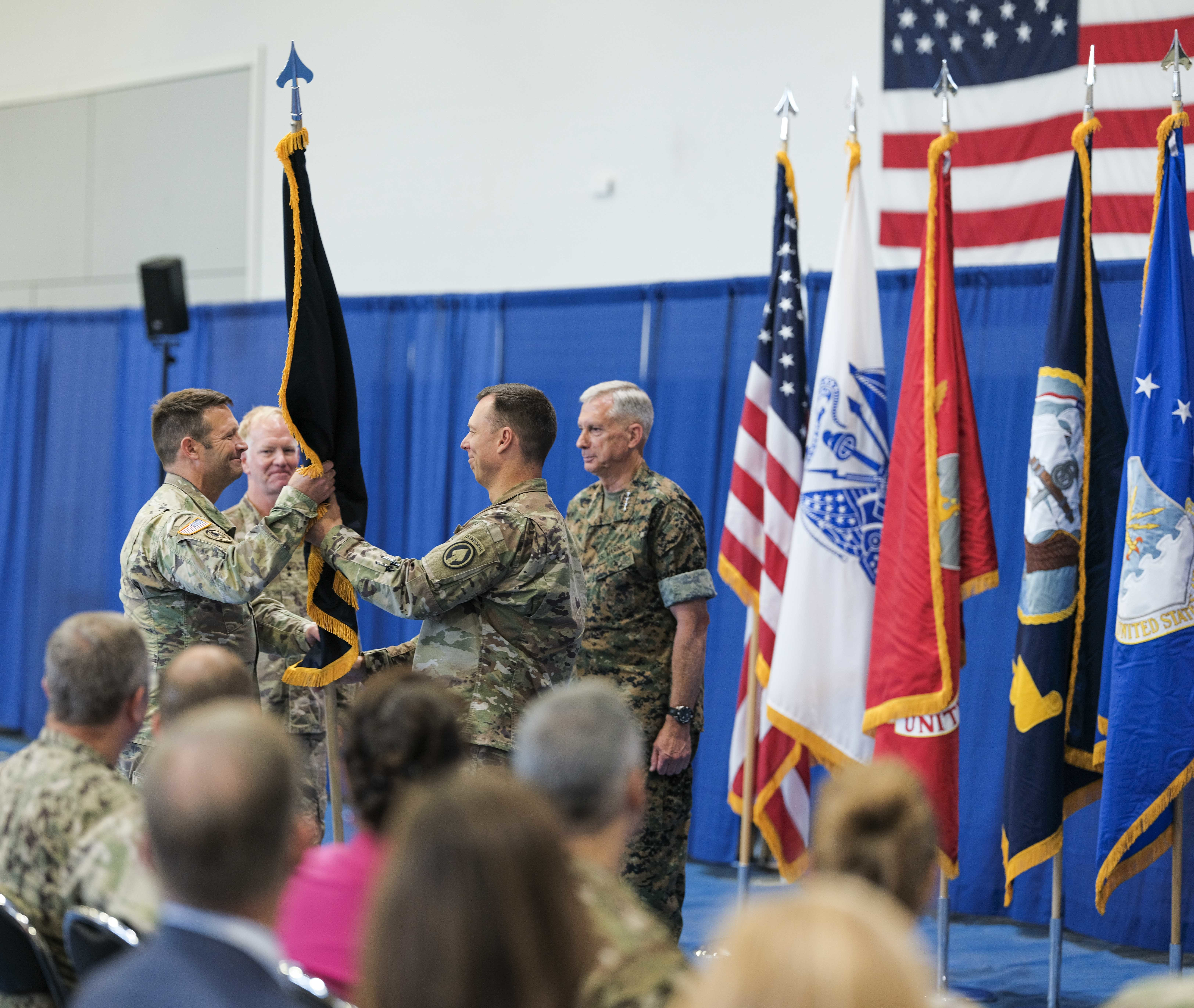 U.S. Air Force Brig. Gen. Dagvin R.M. Anderson hands the SOCAFRICA guidon to Command Sgt. Maj. Lyle H. Marsh during a change of command ceremony for Special Operations Command Africa at Kelley Barracks, Stuttgart, Germany, June 28, 2019. Special Operations Command Africa supports U.S. Africa Command by counter violent extremist organizations, building the military capacity of key partners in Africa and protecting U.S. personnel and facilities. (U.S. Army photo by Sgt. 1st Class Daniel Love/Released)