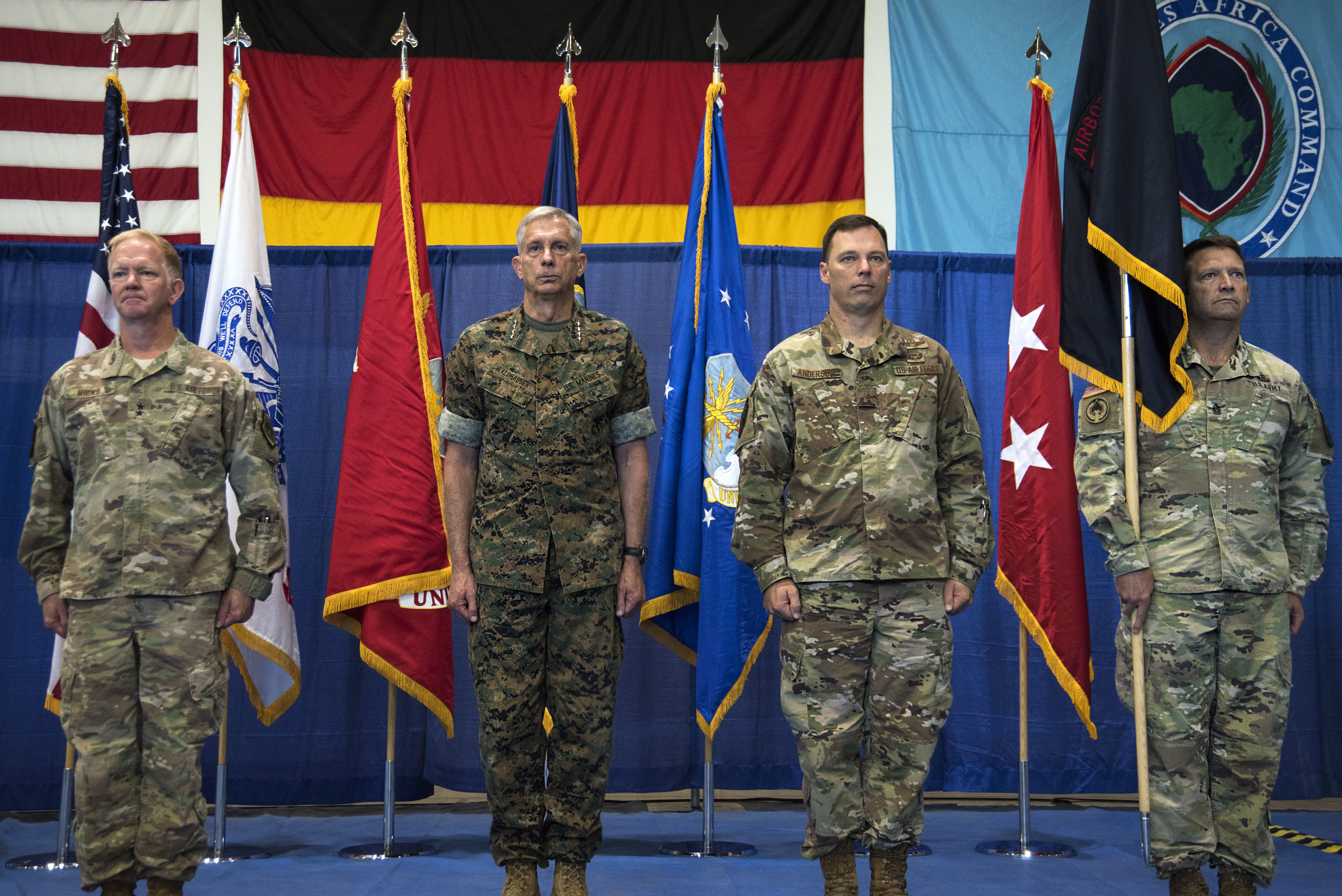 The official party stands at attention following the passing of the Special Operations Command Africa guidon during the SOCAFRICA change of command ceremony at Kelley Barracks, Stuttgart, Germany, June 28, 2019. Special Operations Command Africa supports U.S. Africa Command by counter violent extremist organizations, building the military capacity of key partners in Africa and protecting U.S. personnel and facilities. (U.S. Navy photo by Mass Communication Specialist 1st Class Christopher Hurd/Released)