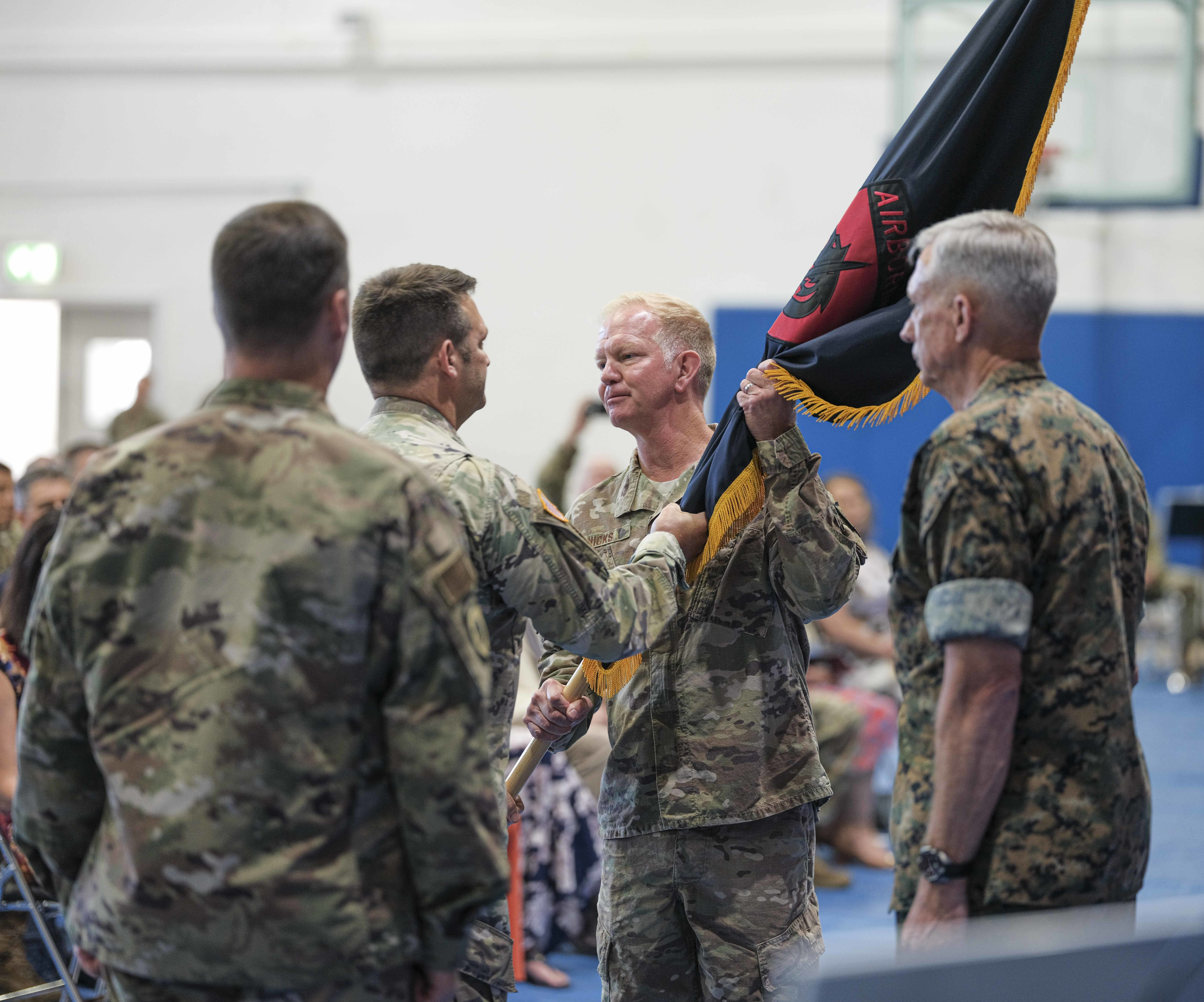 U.S. Air Force Maj. Gen. J. Marcus Hicks, outgoing commander of Special Operations Command Africa, hands the SOCAFRICA guidon to Command Sgt. Maj. Lyle H. Marsh during a change of command ceremony for SOCAFRICA at Kelley Barracks, Stuttgart, Germany, June 28, 2019. Special Operations Command Africa supports U.S. Africa Command by counter violent extremist organizations, building the military capacity of key partners in Africa and protecting U.S. personnel and facilities. (U.S. Army photo by Sgt. 1st Class Daniel Love/Released)