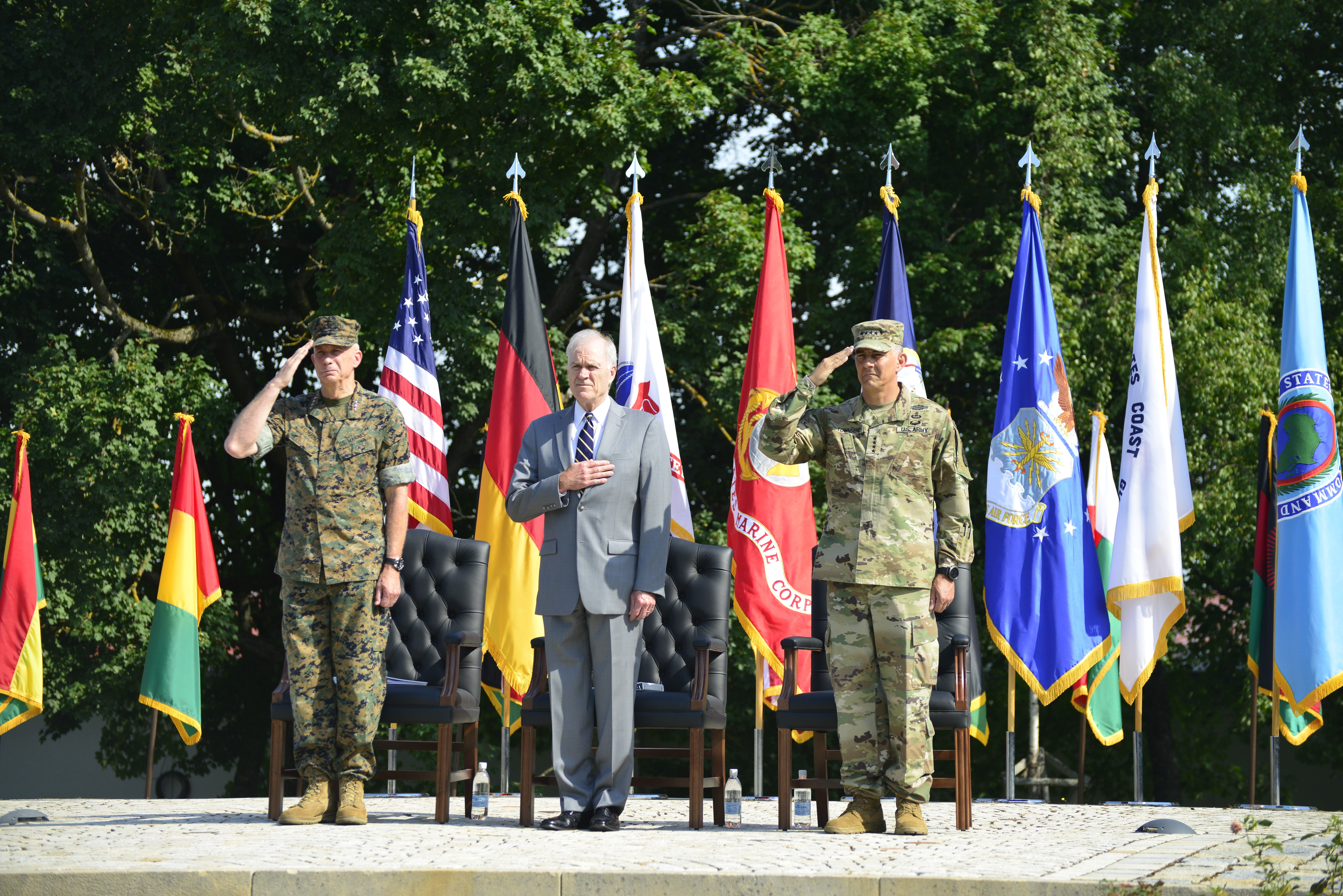 From left, Marine Corps Gen. Thomas D. Waldhauser, outgoing commander, Performing the Duties of the Deputy Secretary of Defense Richard V. Spencer and Army Gen. Stephen J. Townsend, incoming commander, salute a joint color guard during the AFRICOM change of command at Patch Barracks in Stuttgart, Germany, July 26, 2019. Townsend became the fifth AFRICOM commander. (U.S. Army photo by Takisha Miller/Released)