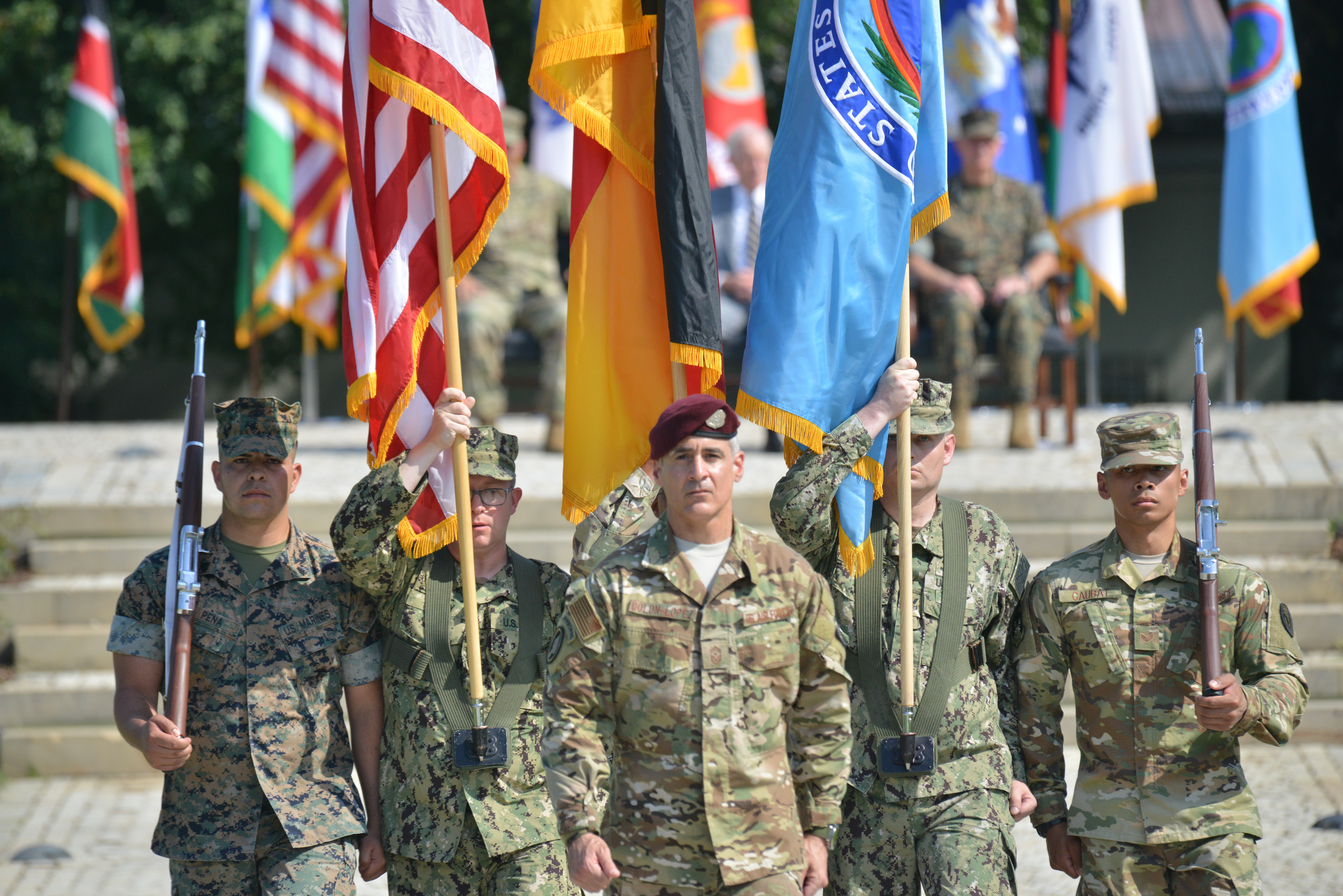 Air Force Chief Master Sgt. Ramon Colon-Lopez, command senior enlisted leader for U.S. Africa Command, leads a a joint color guard during the AFRICOM change of command at Patch Barracks in Stuttgart, Germany, July 26, 2019. AFRICOM is one of six of the U.S. Defense Department's geographic unified commands and is responsible to the Secretary of Defense for military relations with African nations, the African Union, and African regional security organizations. (U.S. Marine photo by Gunnery Sgt. Christian LeBlanc/Released)
