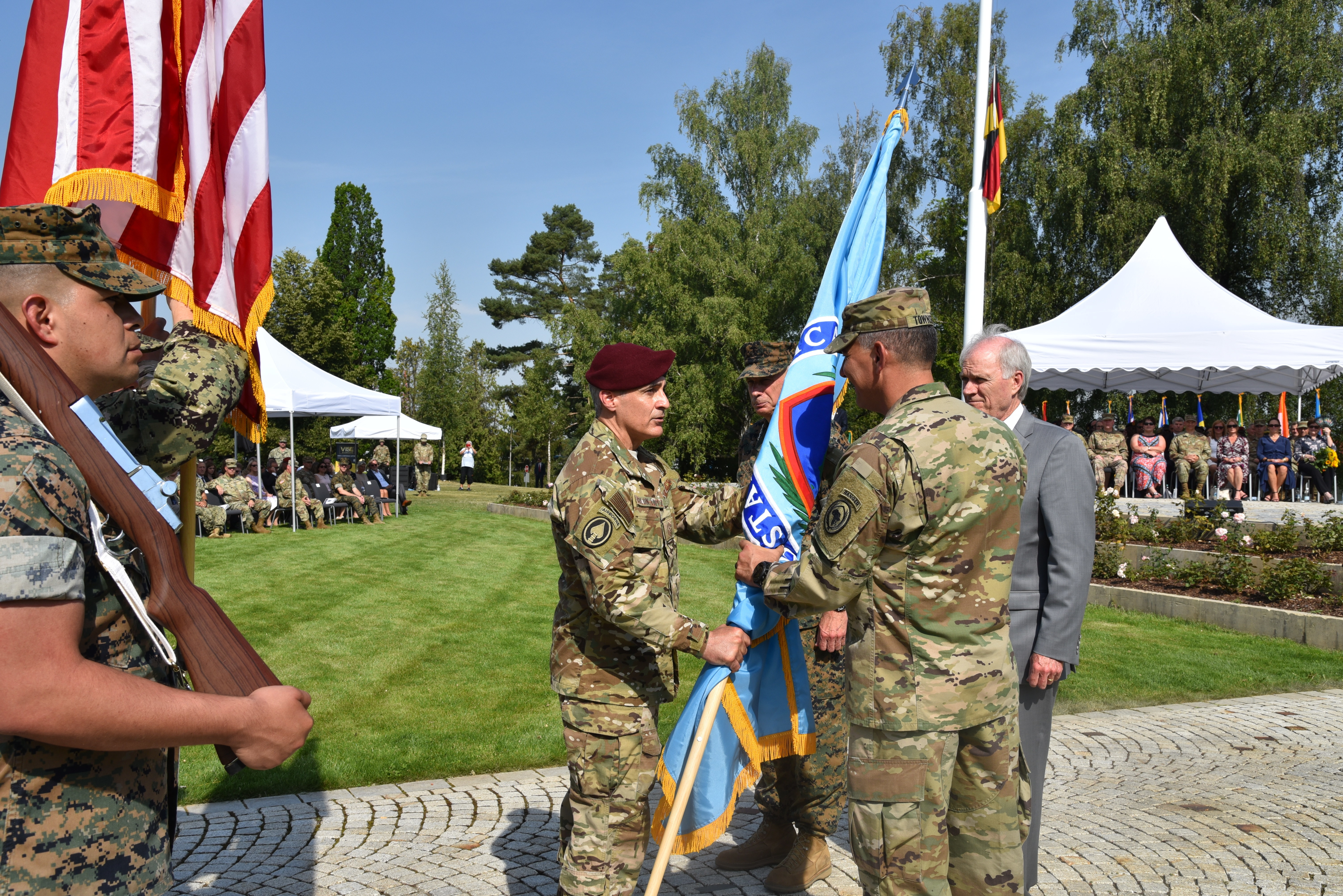 Army Gen. Stephen J. Townsend, incoming commander, hands the AFRICOM guidon to Air Force Chief Master Sgt. Ramon Colon-Lopez, AFRICOM senior enlisted leader, during a change of command ceremony at Patch Barracks in Stuttgart, Germany, July 26, 2019. AFRICOM is one of six of the U.S. Defense Department's geographic unified commands and is responsible to the Secretary of Defense for military relations with African nations, the African Union, and African regional security organizations. (U.S. Army photo by Takisha Miller/Released)