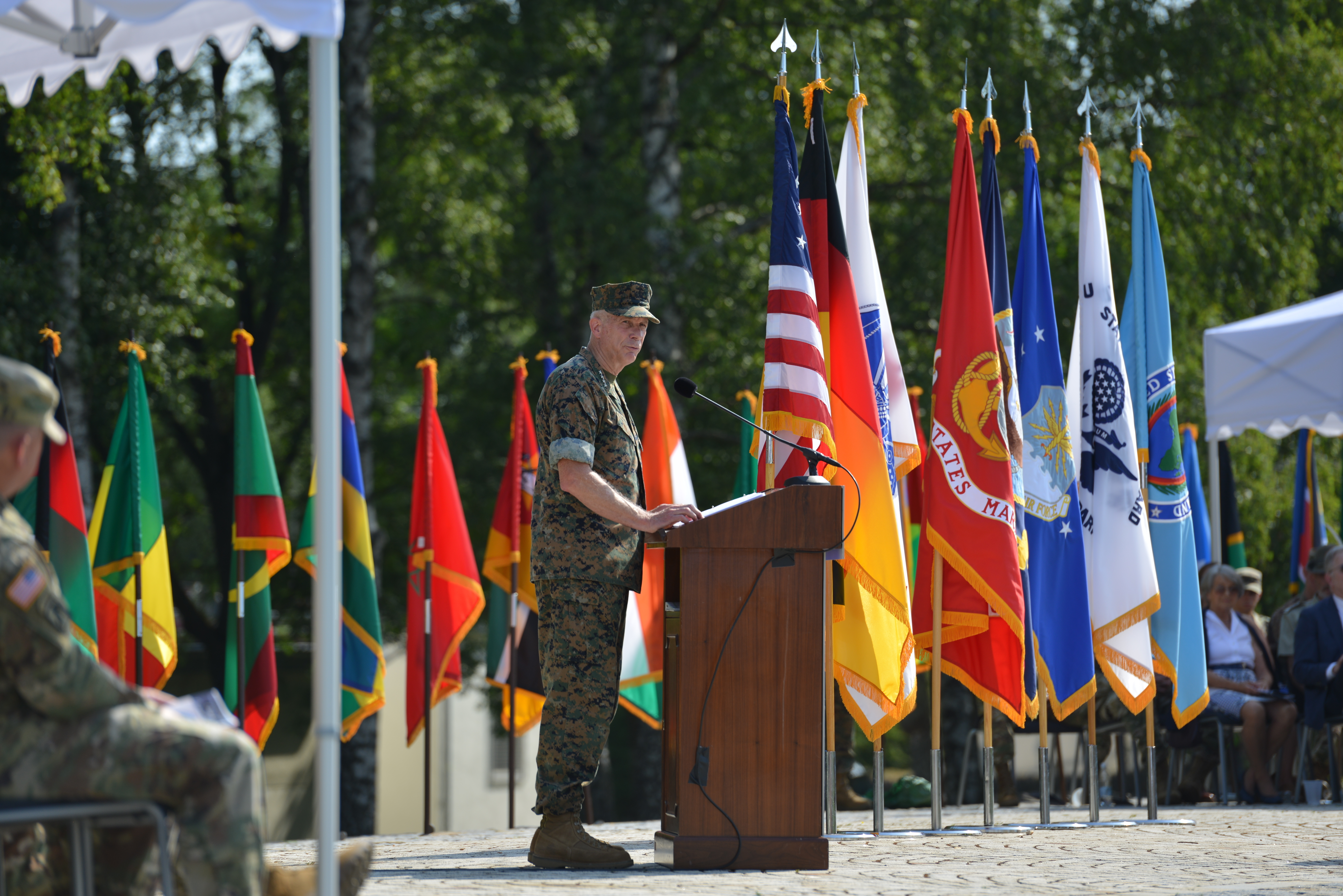 Marine Corps Gen. Thomas D. Waldhauser, outgoing commander, speaks during the AFRICOM change of command ceremony at Patch Barracks in Stuttgart, Germany, July 26, 2019. AFRICOM is one of six of the U.S. Defense Department's geographic unified commands and is responsible to the Secretary of Defense for military relations with African nations, the African Union, and African regional security organizations. (U.S. Army photo by Jason Johnston/Released)