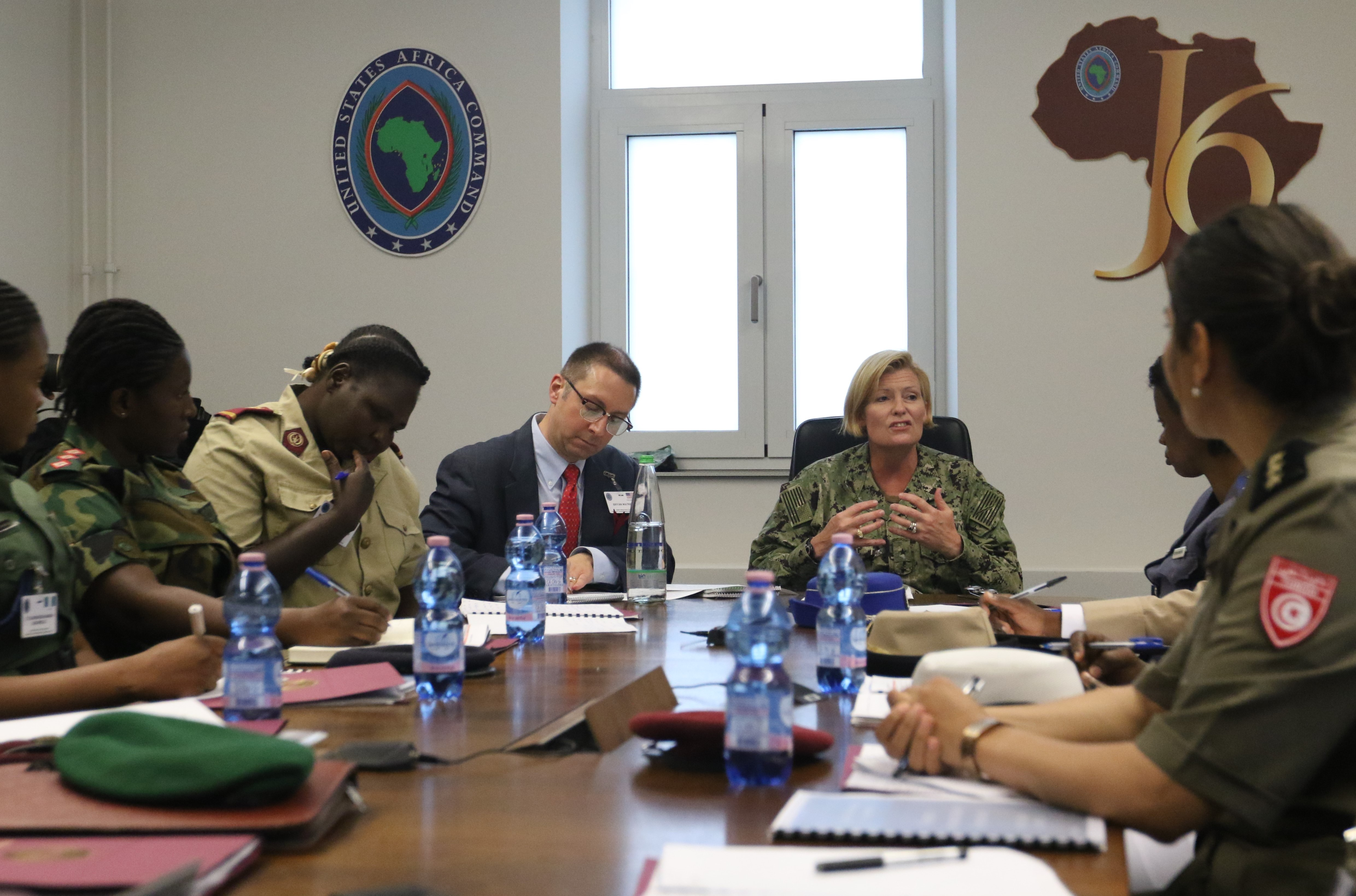 Rear Adm. Heidi Berg, Director of Intelligence-J2, U.S. Africa Command, speaks to the participants of the AFRICOM Women's Communication Symposium, at Kelly Barracks, Stuttgart, Germany, July 29, 2019.