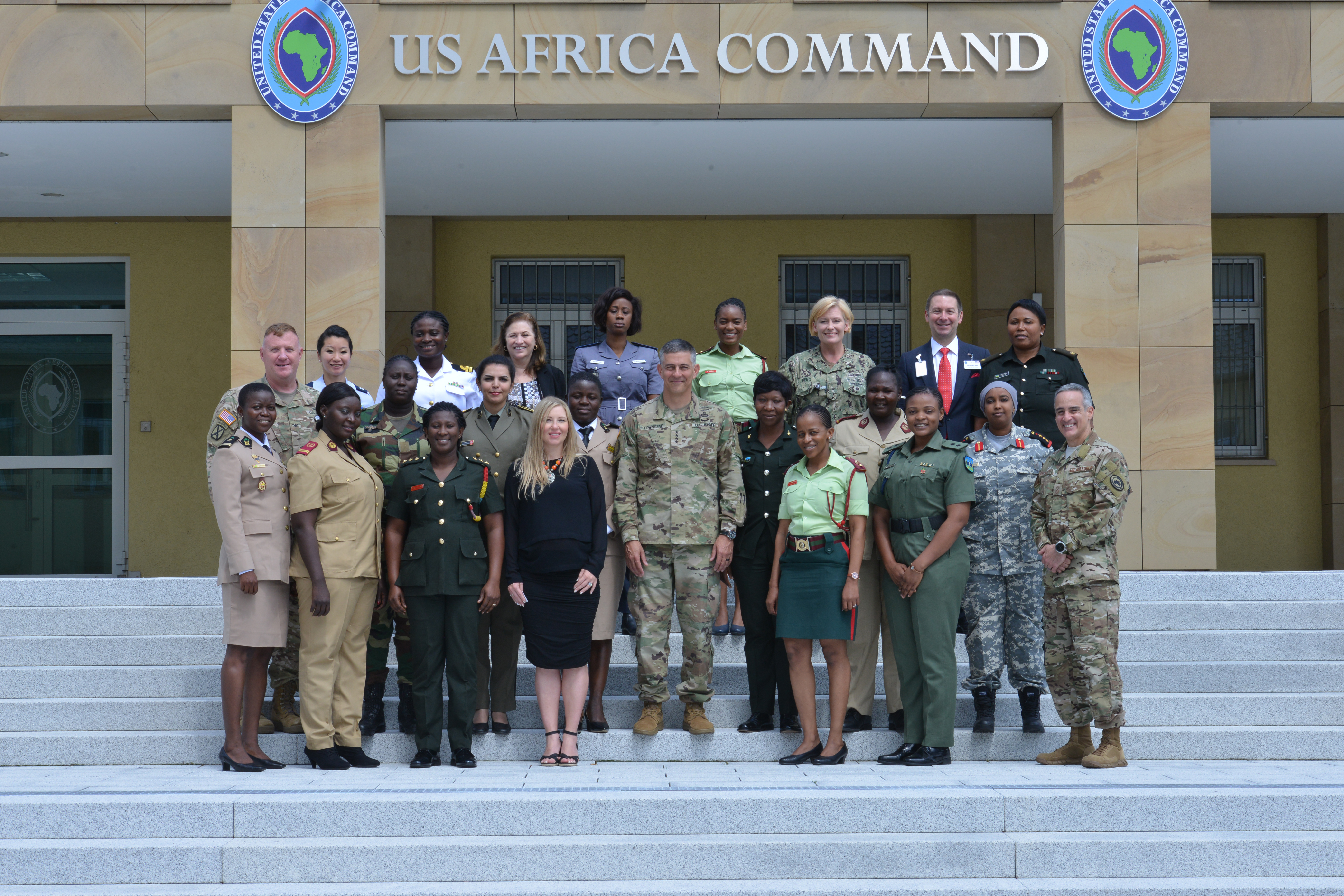 Participants of the 2019 U.S. Africa Command-sponsored, Women's Communication Symposium pose for a photo with AFRICOM Commanding General, Army Gen. Stephen J. Townsend, and AFRICOM Senior Enlisted Leader, Chief Master Sgt. Ramon Colon-Lopez, at the AFRICOM Headquarters, Aug. 2, 2019. 