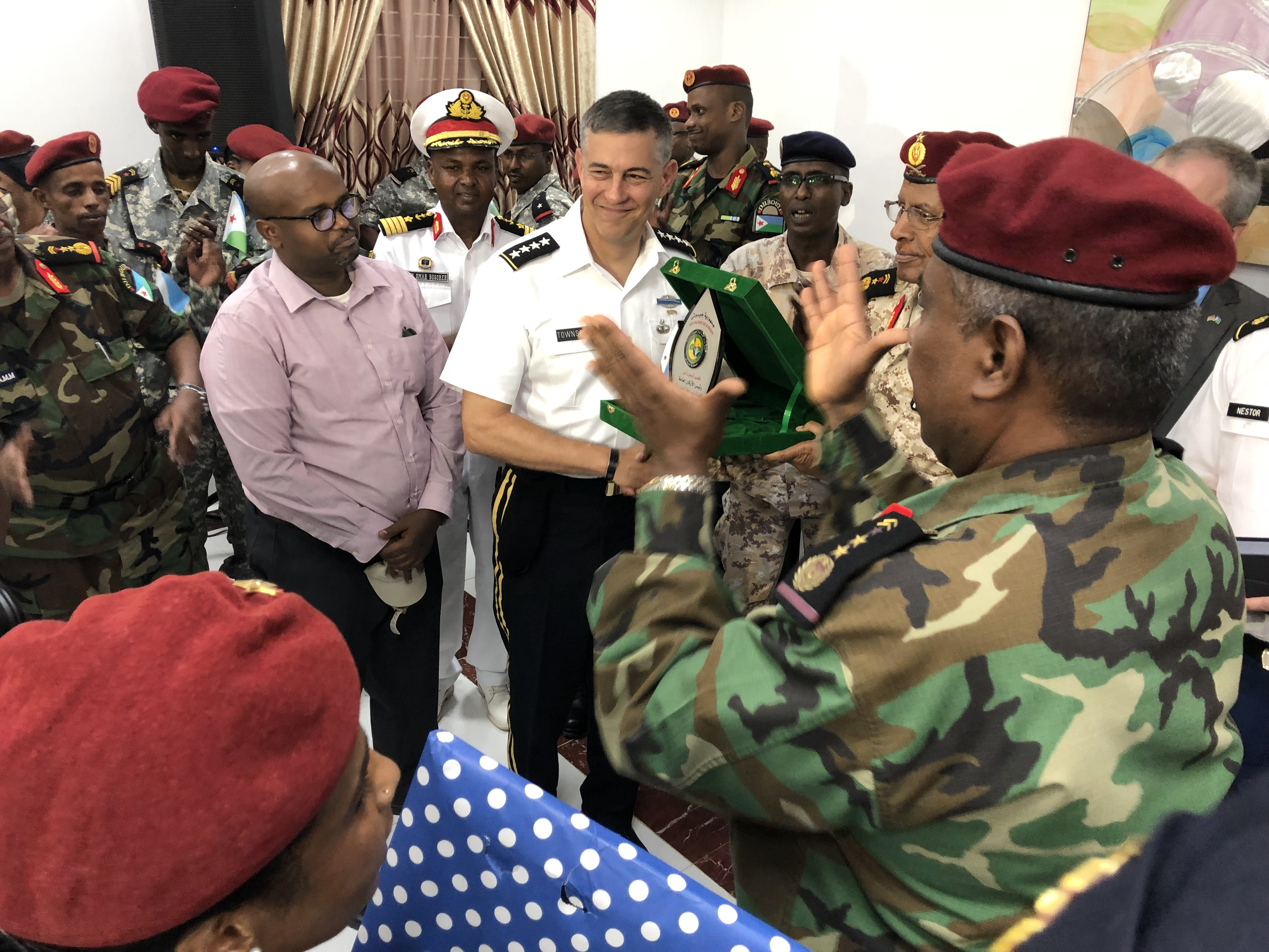 U.S. Army Gen. Stephen Townsend, commander of U.S. Africa Command, exchanges gifts with Djiboutian military officials during a visit to Djibouti Aug. 8, 2019. Townsend visited Djibouti as part of his first visit to Africa since taking command.