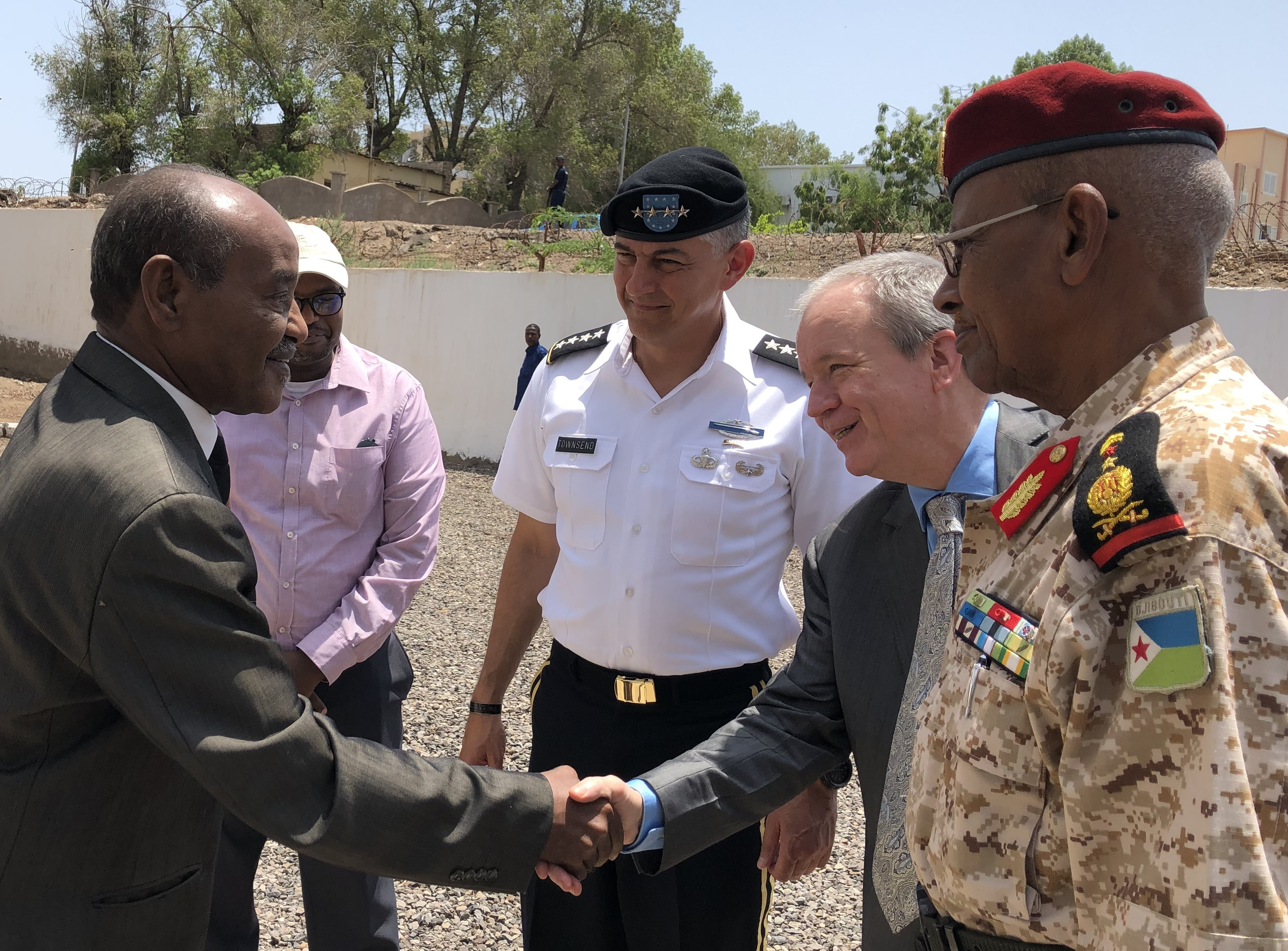 Amb. Larry André, U.S. ambassador to Djibouti, shakes hands with Hassan Omar Mohammed, Djiboutian minister of defense Aug. 8, 2019. U.S. Army Gen. Stephen Townsend visited Djibouti as part of his first visit to Africa since taking command of U.S. Africa Command July 26.