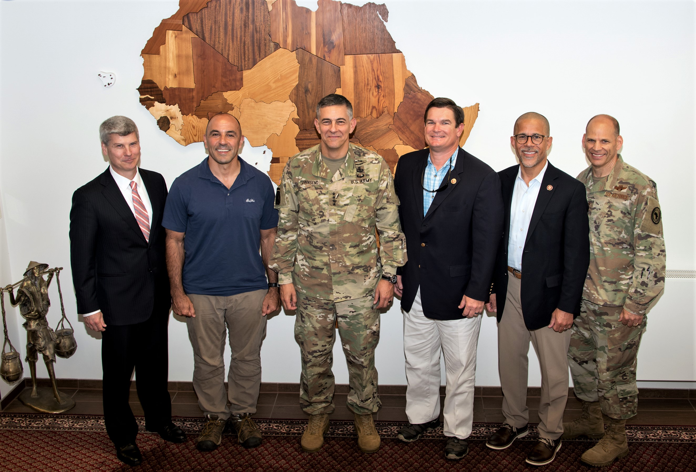 A congressional delegation poses with U.S Africa Command senior leaders during a tour Aug. 23, 2019. The visit led by Congresswoman Maxine Waters was to gain insight about how the command's operations and activities support the U.S. strategy for Africa. (U.S. Army photo by Takisha Miller/Released)