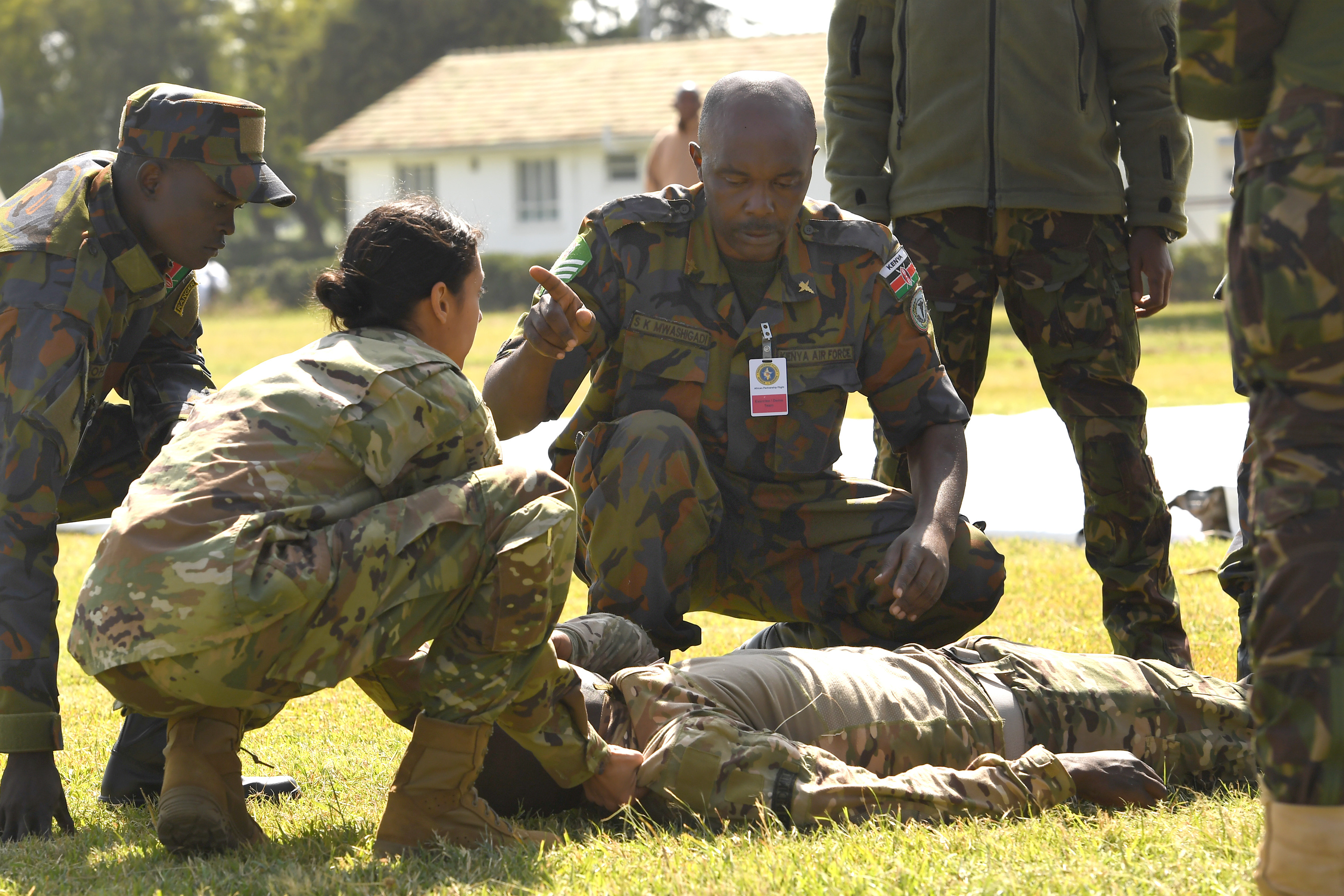 U.S. Air Force Senior Airman Daniela Rizzari, 104th Fighter Wing, Massachusetts Air National Guard medical technician, reviews checking airways with Kenya air force nurse Senior Sgt. Sospeter Mwashigadi, during a tactical combat casualty care demonstration at the African Partnership Flight Kenya 2019 event, Laikipia Air Base, Kenya, August 21, 2019. The TCCC demonstrated all three phases of care to include care under fire, tactical field care and tactical evacuation care. (U.S. Air Force photo by Master Sgt. Renae Pittman)