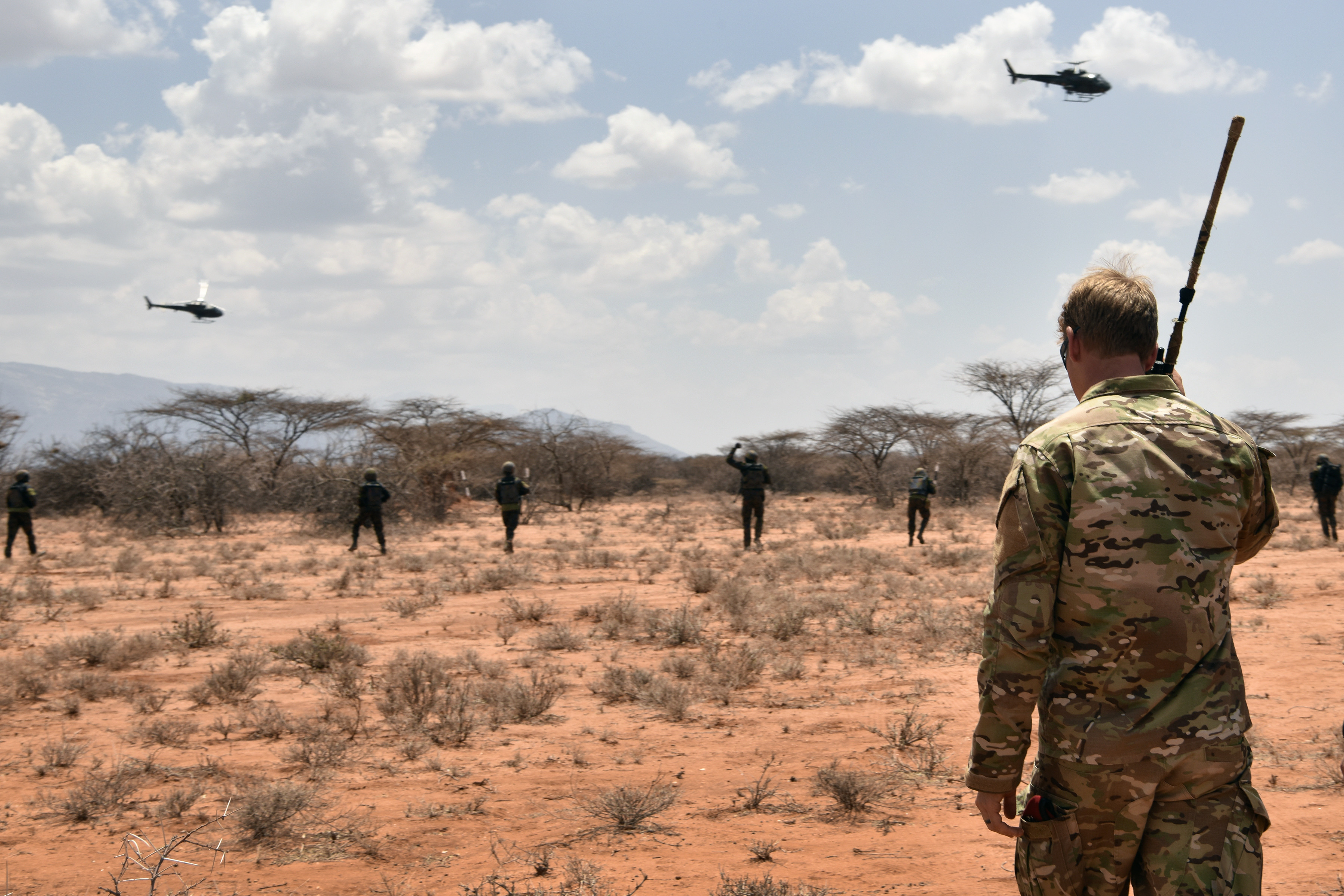 U.S. Air Force special tactics Airman with the 22nd Special Tactics Squadron observes the final demonstration of the African Partnership Flight Kenya 2019 program at Larisoro Air Strip, Kenya, August 25, 2019. The culmination event, Linda Rhino 2, incorporated multiple skills covered during the week-long program including combat search and rescue, aeromedical evacuation and personnel recovery command and control. (U.S. Air Force photo by Master Sgt. Renae Pittman)
