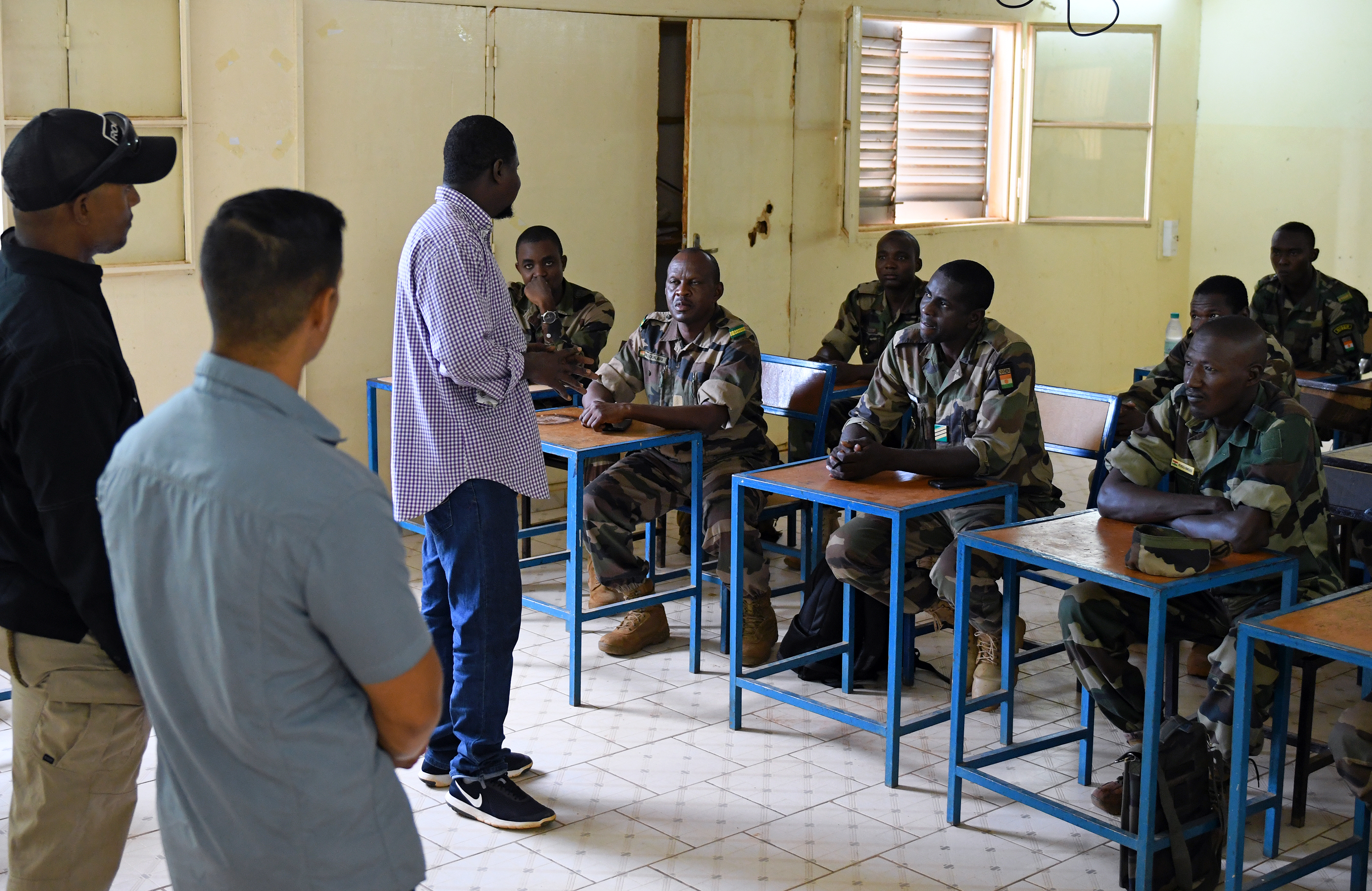 Forces Armées Nigeriennes (Nigerien Armed Forces) Genie Unit members learn about improvised explosive devices during an IED Awareness Course taught by members of the 768th Expeditionary Air Base Squadron Explosive Ordnance Disposal team and Security Forces Air Advisors in Niamey, Niger, Oct. 11, 2019. The course is part of a curriculum spanning several months designed to improve the FAN's effectiveness and survivability once they deploy to combat the violent extremist organizations in West Africa. (U.S. Air Force photo by Staff Sgt. Alex Fox Echols III)