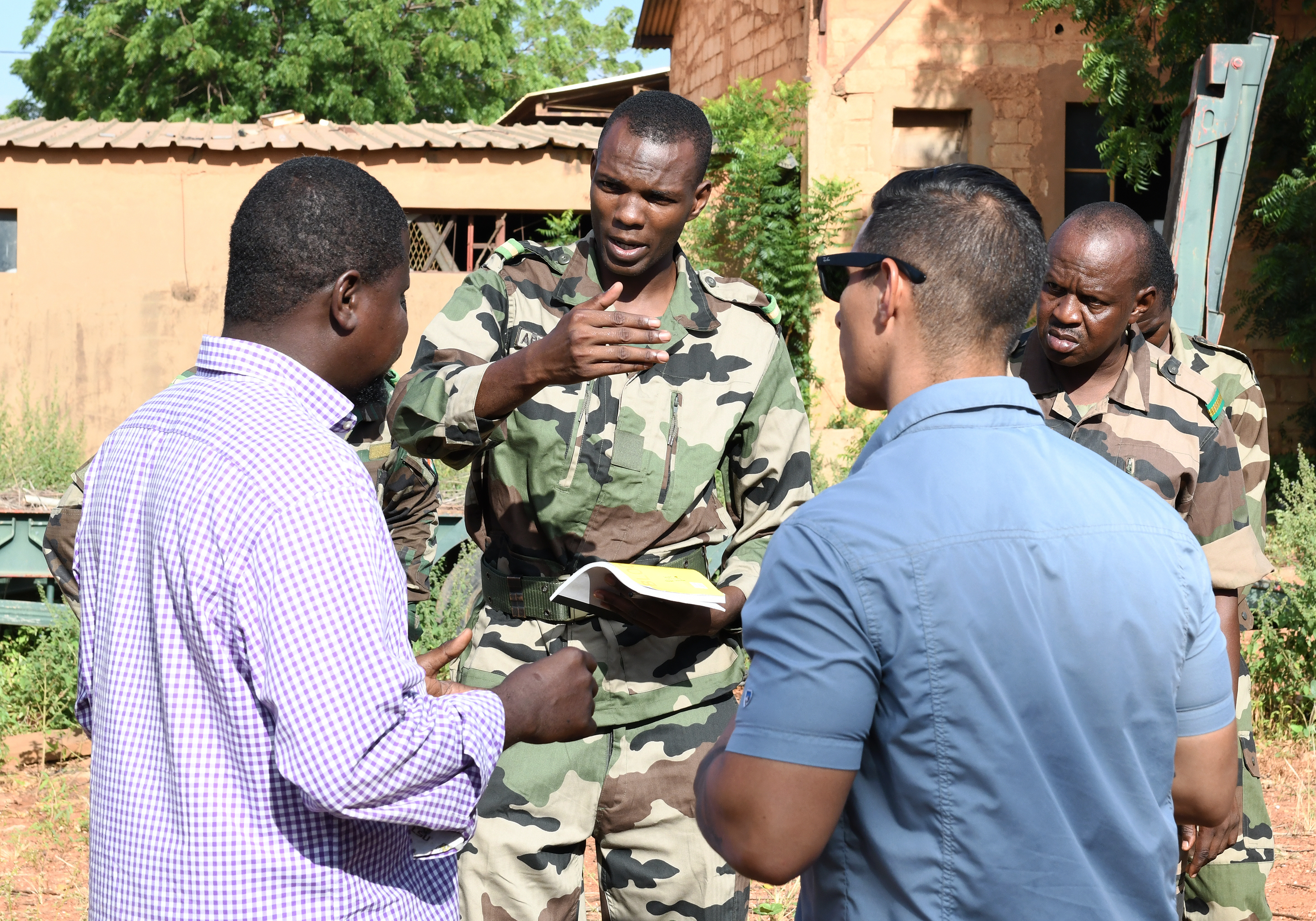 Forces Armées Nigeriennes (Nigerien Armed Forces) 2nd Lt. Amadou Belloh Abdoulaye, Genie Unit combat engineer, speaks to instructors during an Improvised Explosive Device Awareness Course in Niamey, Niger, Oct. 11, 2019. During the week-long course, the 768th Expeditionary Air Base Squadron Explosive Ordnance Disposal team and Security Forces Air Advisors taught FAN personnel valuable skills for the deployed environment such as how to locate and react to an IED, how to set up a cordon and the procedures to clear the area. (U.S. Air Force photo by Staff Sgt. Alex Fox Echols III)