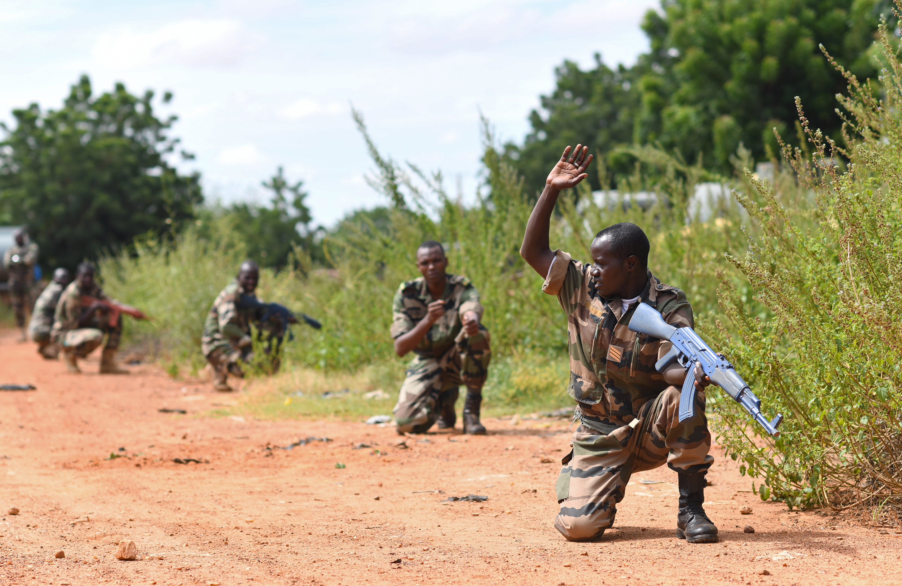 Forces Armées Nigeriennes (Nigerien Armed Forces) Genie Unit members crouch, alert to a simulated threat during an Improvised Explosive Device Awareness Course in Niamey, Niger, Oct. 11, 2019. During the week-long course, the 768th Expeditionary Air Base Squadron Explosive Ordnance Disposal team and Security Forces Air Advisors taught FAN personnel valuable skills for the deployed environment such as how to locate and react to an IED, how to set up a cordon and the procedures to clear the area. (U.S. Air Force photo by Staff Sgt. Alex Fox Echols III)