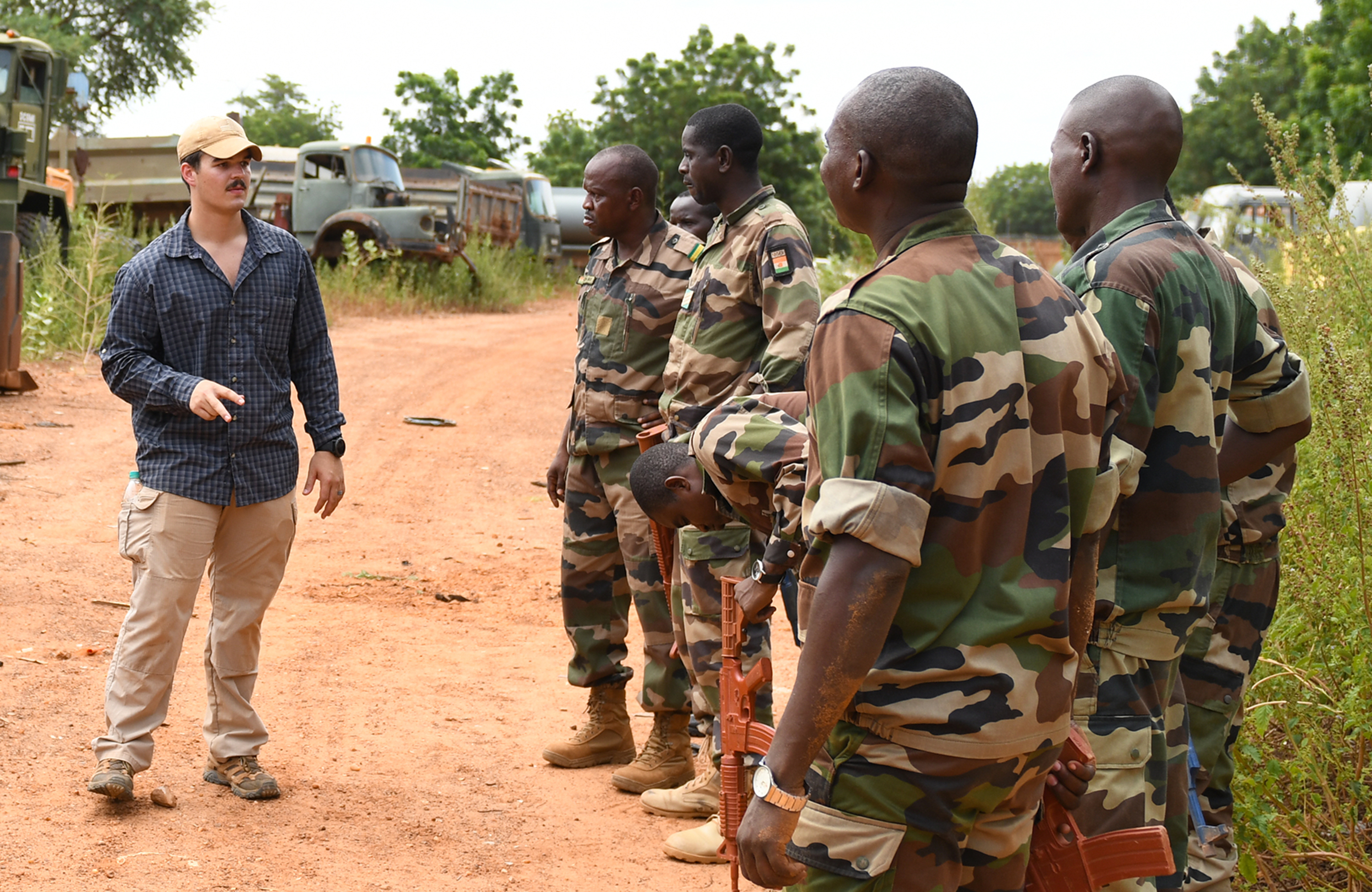 U.S. Air Force Senior Airman Caleb Love, 768th Expeditionary Air Base Squadron Explosive Ordnance Disposal team member, teaches members of the Forces Armées Nigeriennes (Nigerien Armed Forces) Genie Unit how to locate an improvised explosive device during an IED Awareness Course in Niamey, Niger, Oct. 11, 2019. During this week-long course, the FAN learned how to locate and react to an IED, set up a cordon and procedures to clear the area. (U.S. Air Force photo by Staff Sgt. Alex Fox Echols III)