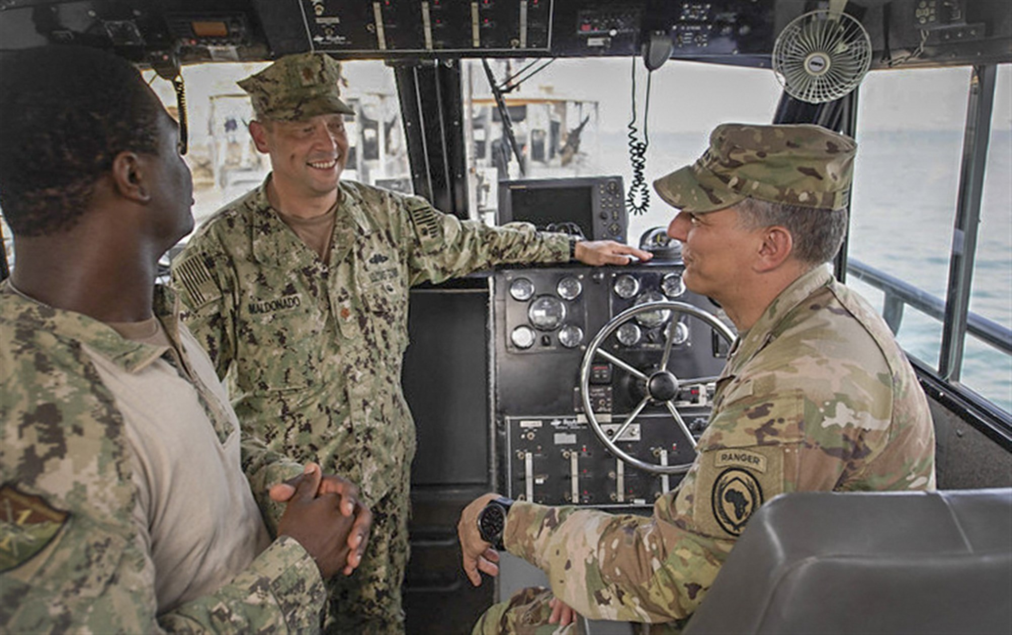 U.S. Army Gen. Stephen J. Townsend, commander, U.S. Africa Command, speaks with U.S. Coast Guard Lt. Cmdr. Jose Maldonado, middle, aboard a 34-foot Dauntless Sea-Ark during a visit to the Djiboutian navy base during exercise Cutlass Express 2019.2 and International Maritime Exercise 2019 in Djibouti, Djibouti, Nov. 4. Cutlass Express is designed to improve regional cooperation, maritime domain awareness and information sharing practices to increase capabilities between the U.S., East African and Western Indian Ocean nations to counter illicit maritime activity. (U.S. Navy photo by Mass Communication Specialist Seaman Andrea Rumple)