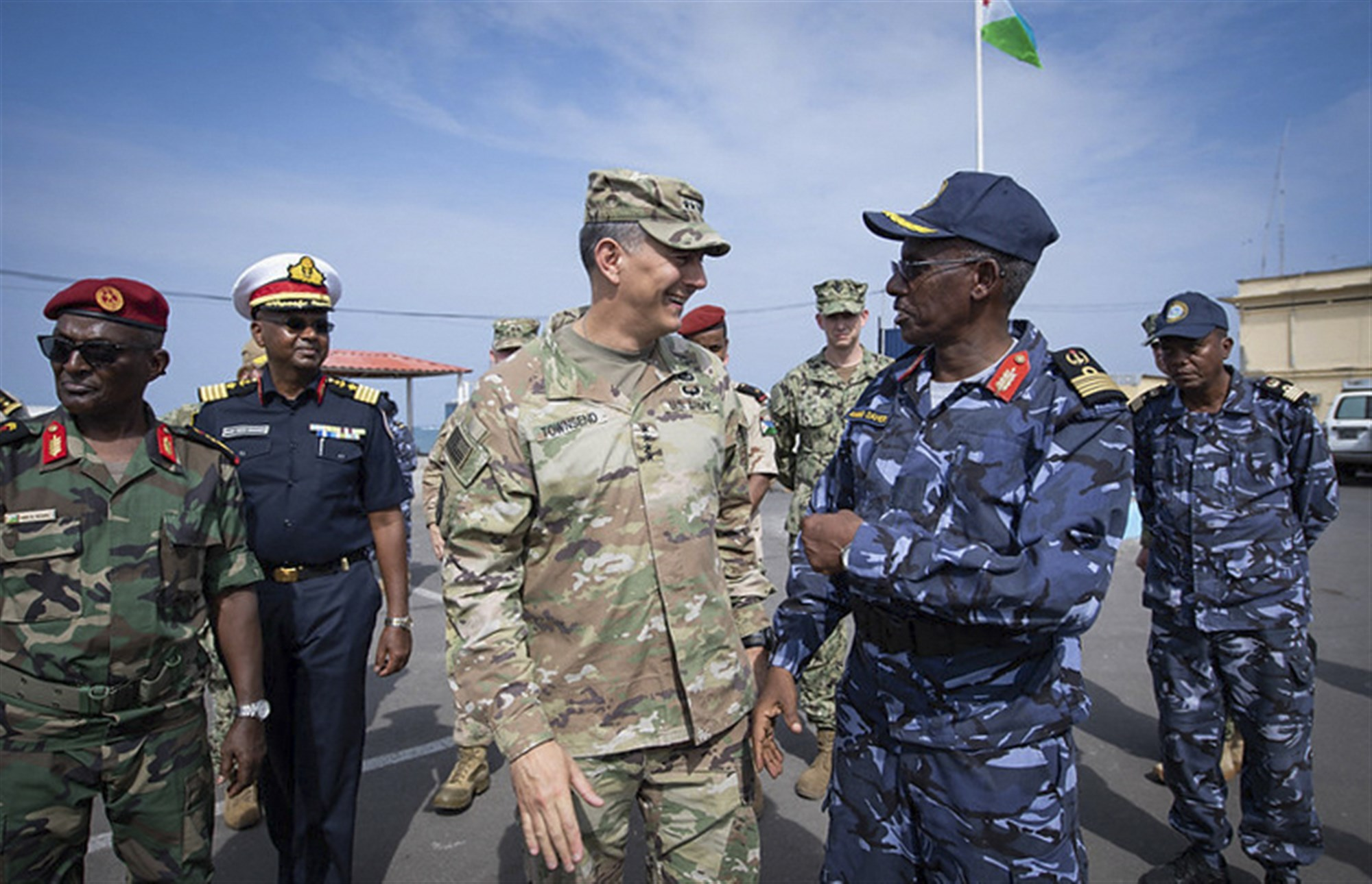 U.S. Army Gen. Stephen J. Townsend, commander, U.S. Africa Command, speaks to Col. Ahmed Daher Djama, commander, Djiboutian navy, at the conclusion of a visit to the Djiboutian navy base during exercise Cutlass Express 2019.2 and International Maritime Exercise 2019 in Djibouti, Djibouti Nov. 4. Cutlass Express is designed to improve regional cooperation, maritime domain awareness and information sharing practices to increase capabilities between the U.S., East African and Western Indian Ocean nations to counter illicit maritime activity. (U.S. Navy photo by Mass Communication Specialist Seaman Andrea Rumple)