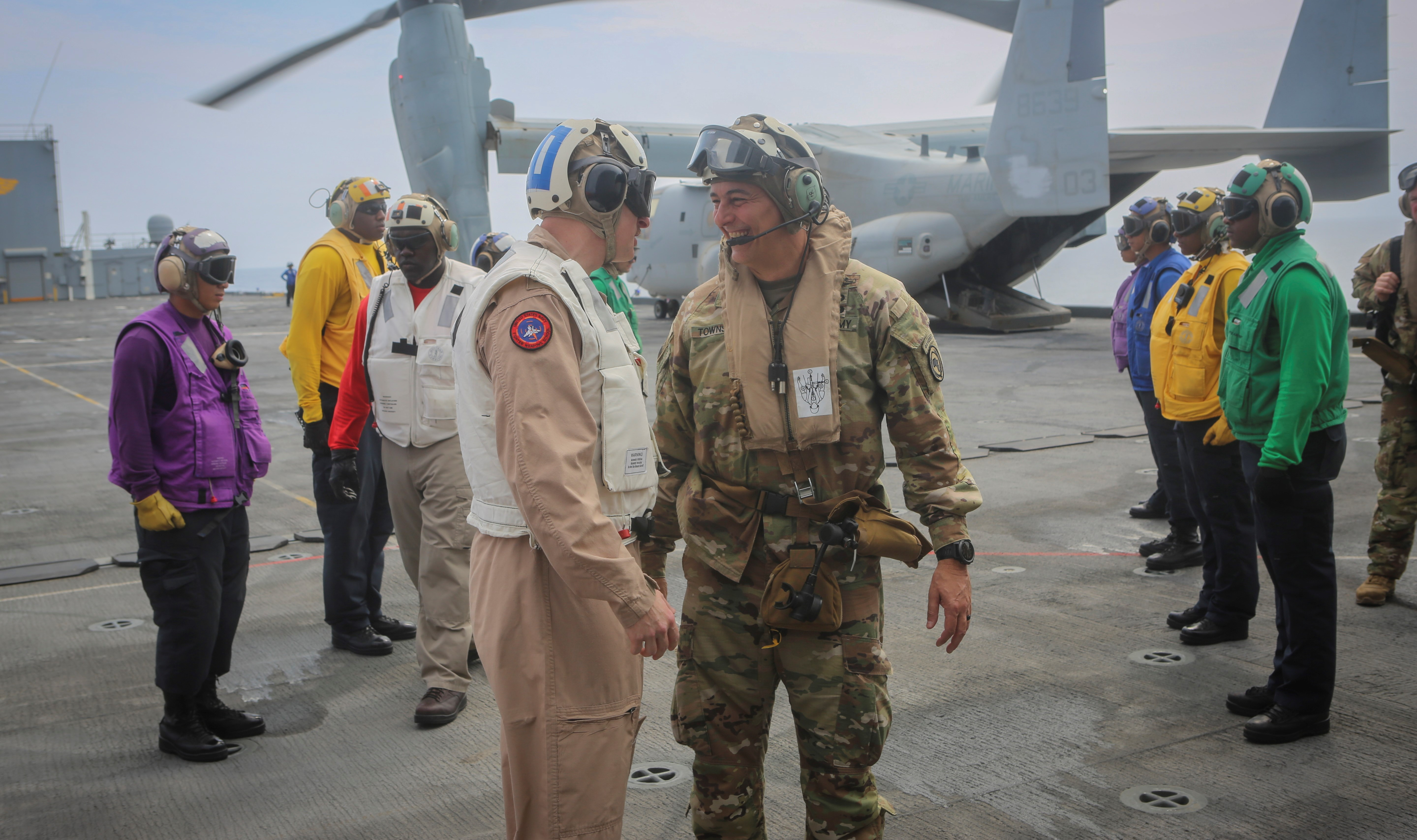 U.S. Army Gen. Stephen J. Townsend, commander, U.S. Africa Command, speaks with Capt. Colin Day, commanding officer of the Expeditionary Mobile Base USS Lewis B. Puller, as he arrives aboard the ship during exercise Cutlass Express 2019.2, Nov. 4, 2019. Cutlass Express is designed to improve regional cooperation, maritime domain awareness and information sharing practices to increase capabilities between the U.S., East African, and Western Indian Ocean nations to counter illicit maritime activity. (U.S. Navy photo by Lewis B. Puller public affairs)