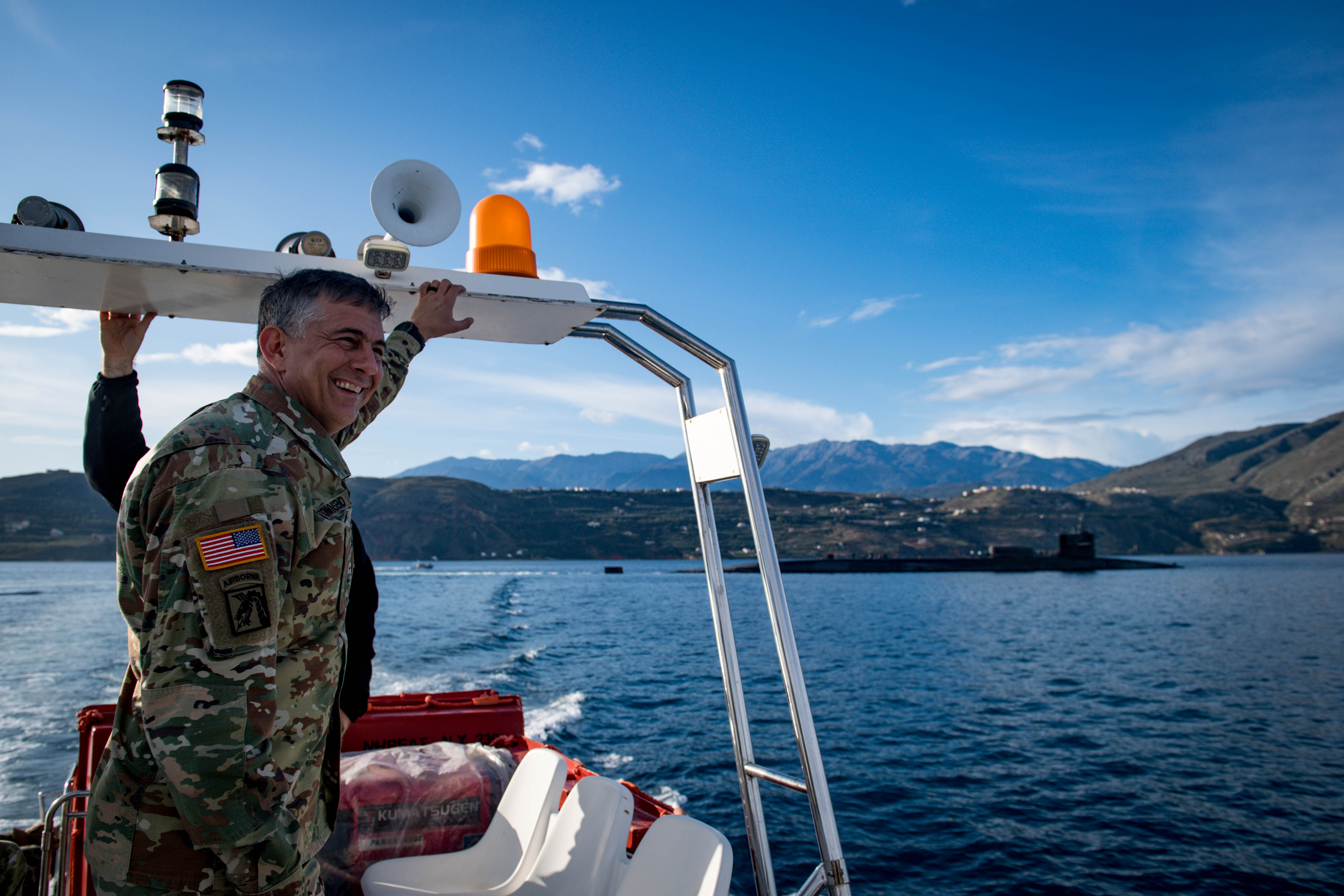 U.S. Army Gen. Stephen J. Townsend, commander, U.S. Africa Command (AFRICOM), stands on a transfer boat after departing the Ohio-class fleet guided-missile submarine USS Florida (SSGN 728), in Naval Support Activity Souda Bay, Greece, Nov. 26, 2019. AFRICOM, a full-spectrum combatant command, is one of the six U.S. Defense Department's geographic combatant commands and is responsible for all DoD operations, exercises, and security cooperation on the African continent, its island nations, and surrounding waters. (U.S. Navy photo by Mass Communication Specialist 2nd Class Jonathan Nelson)