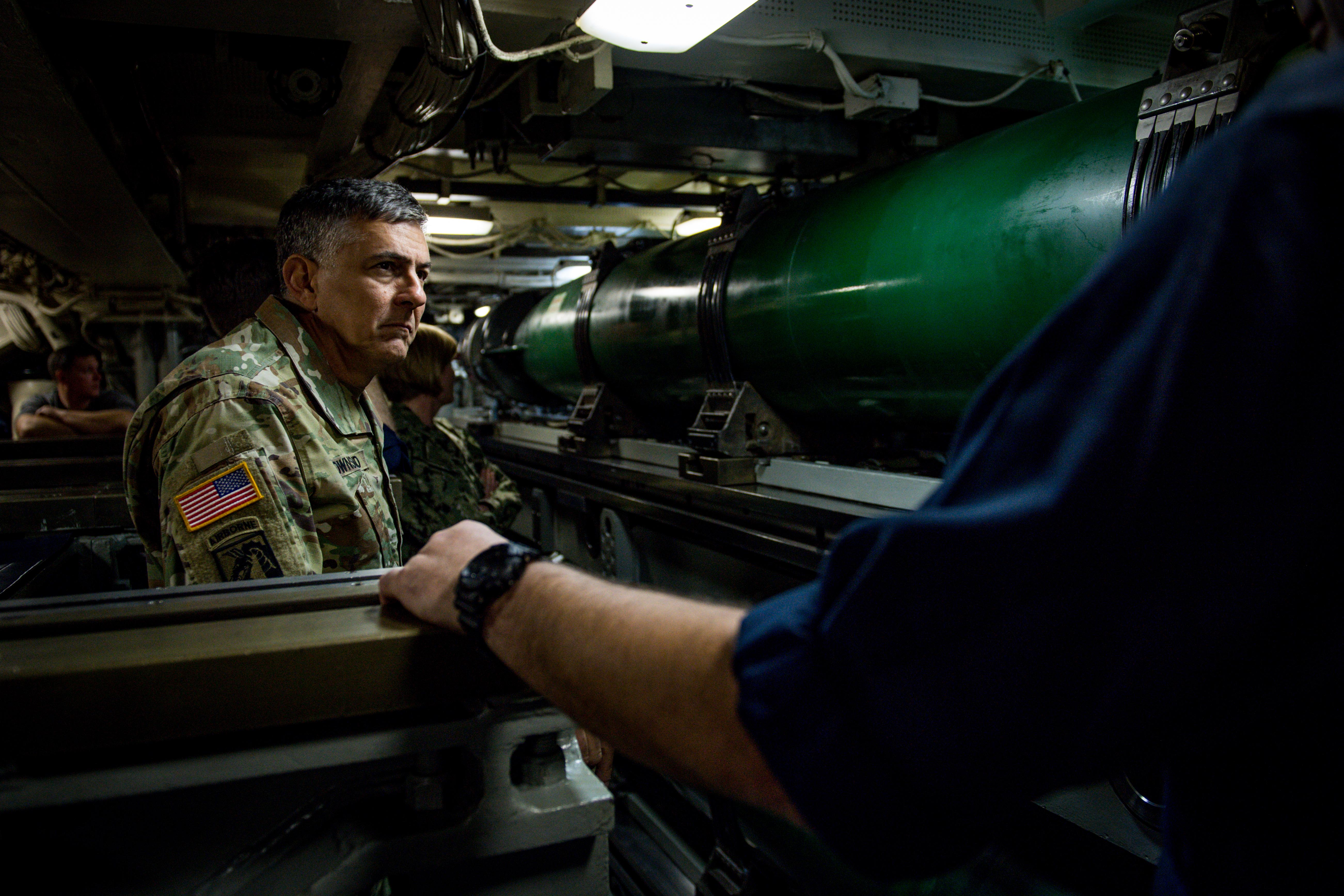U.S. Army Gen. Stephen J. Townsend, commander, U.S. Africa Command (AFRICOM), left, speaks with Command Master Chief Joseph H. Riley, chief of the boat, Ohio-class fleet guided-missile submarine USS Florida (SSGN 728), in the torpedo room aboard the ship in the Mediterranean Sea Nov. 25, 2019. AFRICOM, a full-spectrum combatant command, is one of the six U.S. Defense Department's geographic combatant commands and is responsible for all DoD operations, exercises, and security cooperation on the African continent, its island nations, and surrounding waters. (U.S. Navy photo by Mass Communication Specialist 2nd Class Jonathan Nelson)