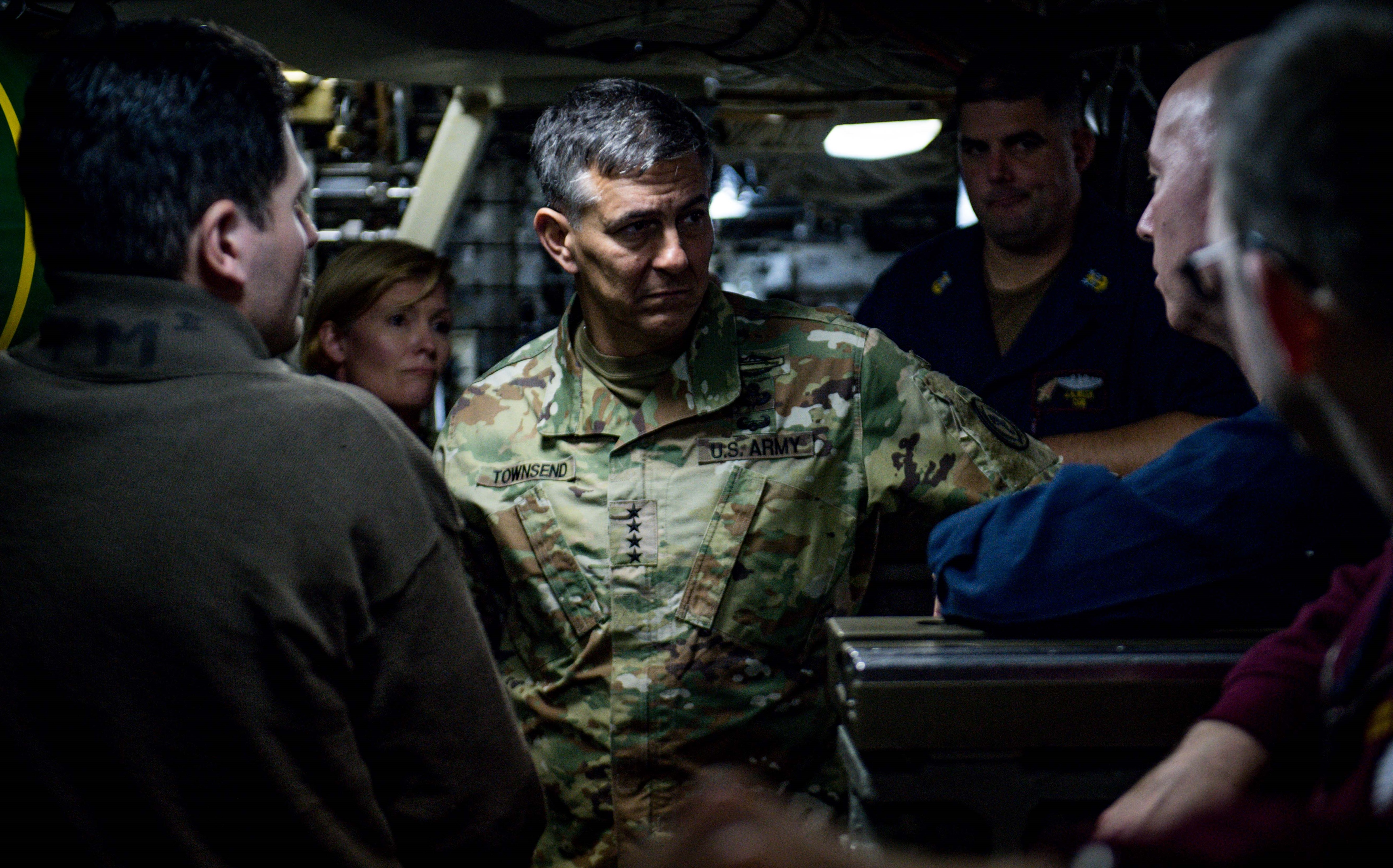U.S. Army Gen. Stephen J. Townsend, commander, U.S. Africa Command (AFRICOM), right, speaks with Rear Adm. William J. Houston, deputy commander, U.S. 6th Fleet (C6F) and commander, Submarine Group (SUBGRU) 8, in the torpedo room aboard the Ohio-class fleet guided-missile submarine USS Florida (SSGN 728) in the Mediterranean Sea Nov. 25, 2019. AFRICOM, a full-spectrum combatant command, is one of the six U.S. Defense Department's geographic combatant commands and is responsible for all DoD operations, exercises, and security cooperation on the African continent, its island nations, and surrounding waters. (U.S. Navy photo by Mass Communication Specialist 2nd Class Jonathan Nelson)