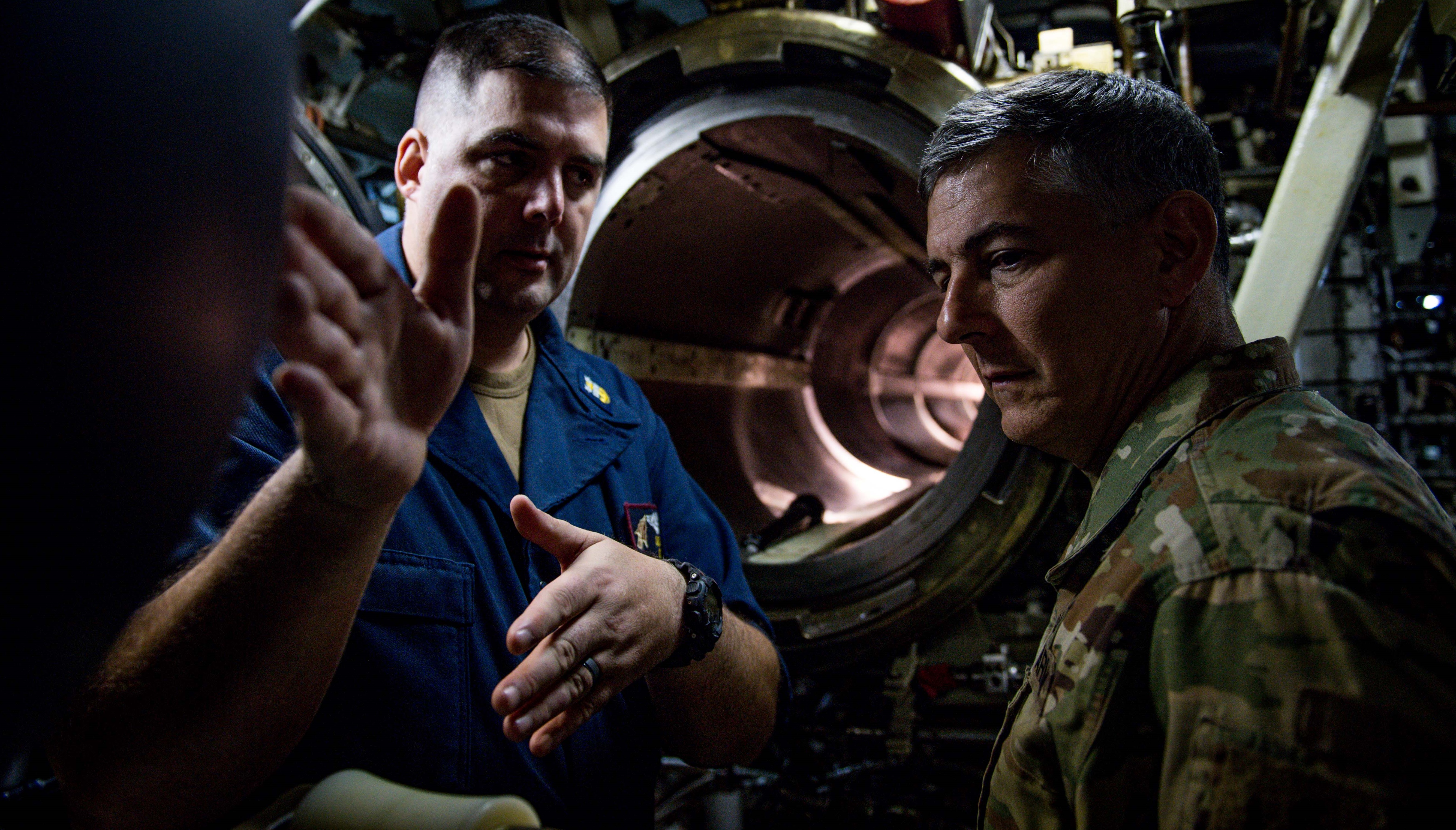 U.S. Army Gen. Stephen J. Townsend, commander, U.S. Africa Command (AFRICOM), right, speaks with Command Master Chief Joseph H. Riley, chief of the boat, Ohio-class fleet guided-missile submarine USS Florida (SSGN 728), in the torpedo room aboard the ship in the Mediterranean Sea Nov. 25, 2019. AFRICOM, a full-spectrum combatant command, is one of the six U.S. Defense Department's geographic combatant commands and is responsible for all DoD operations, exercises, and security cooperation on the African continent, its island nations, and surrounding waters. (U.S. Navy photo by Mass Communication Specialist 2nd Class Jonathan Nelson)